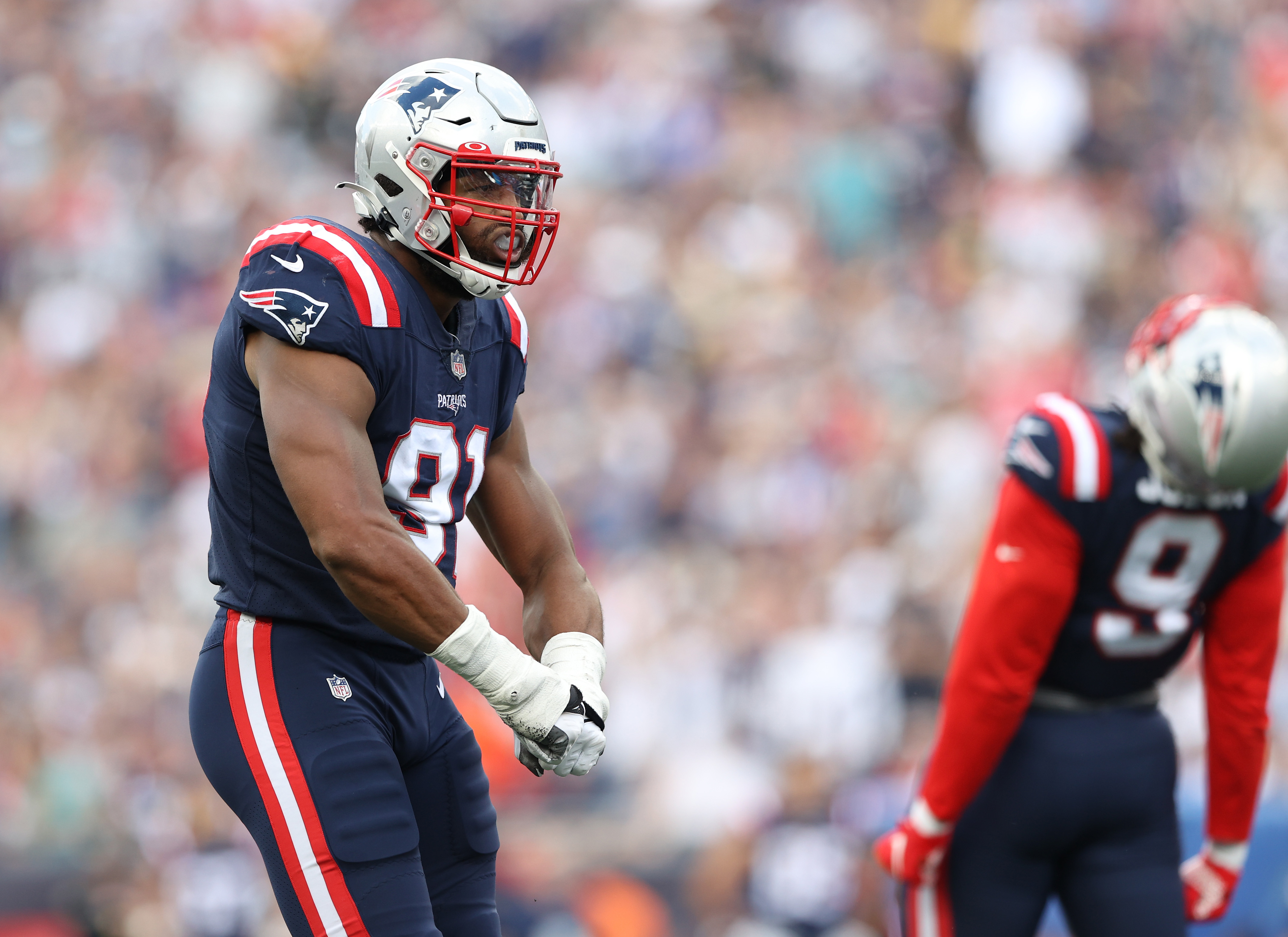 Matt Judon #9 and Deatrich Wise Jr. #91 of the New England Patriots react after a defensive play in the second quarter of the game at Gillette Stadium on September 26, 2021 in Foxborough, Massachusetts.