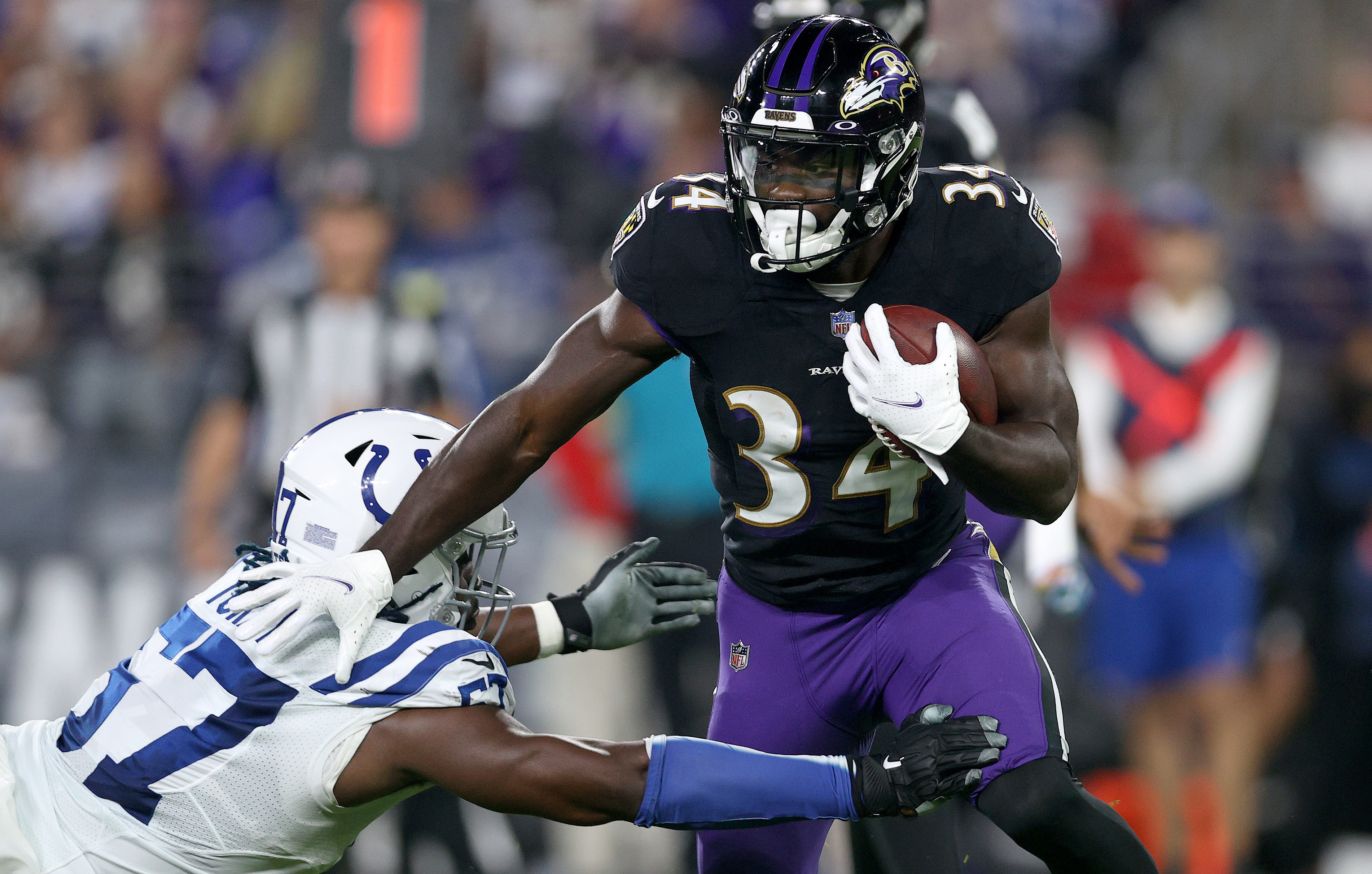 Devonta Freeman #34 of the Baltimore Ravens rushes during the second quarter in a game against the Indianapolis Colts at M&T Bank Stadium on October 11, 2021 in Baltimore, Maryland.