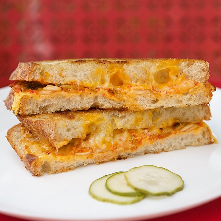 Kimchi grilled cheese comes with American, gruyere, and cheddar at Wise Acre Eatery.