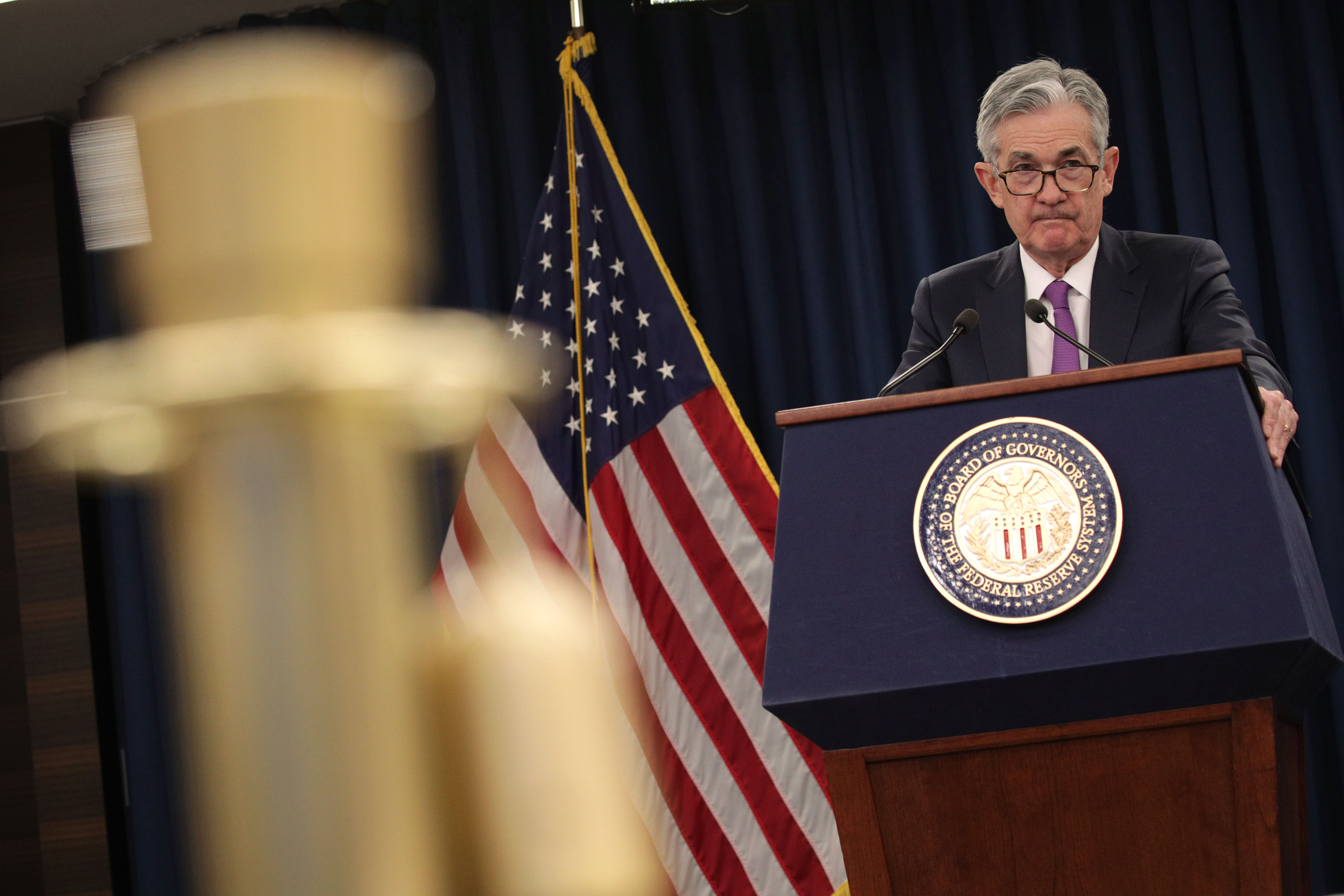 Jerome Powell speaking from behind a lectern.