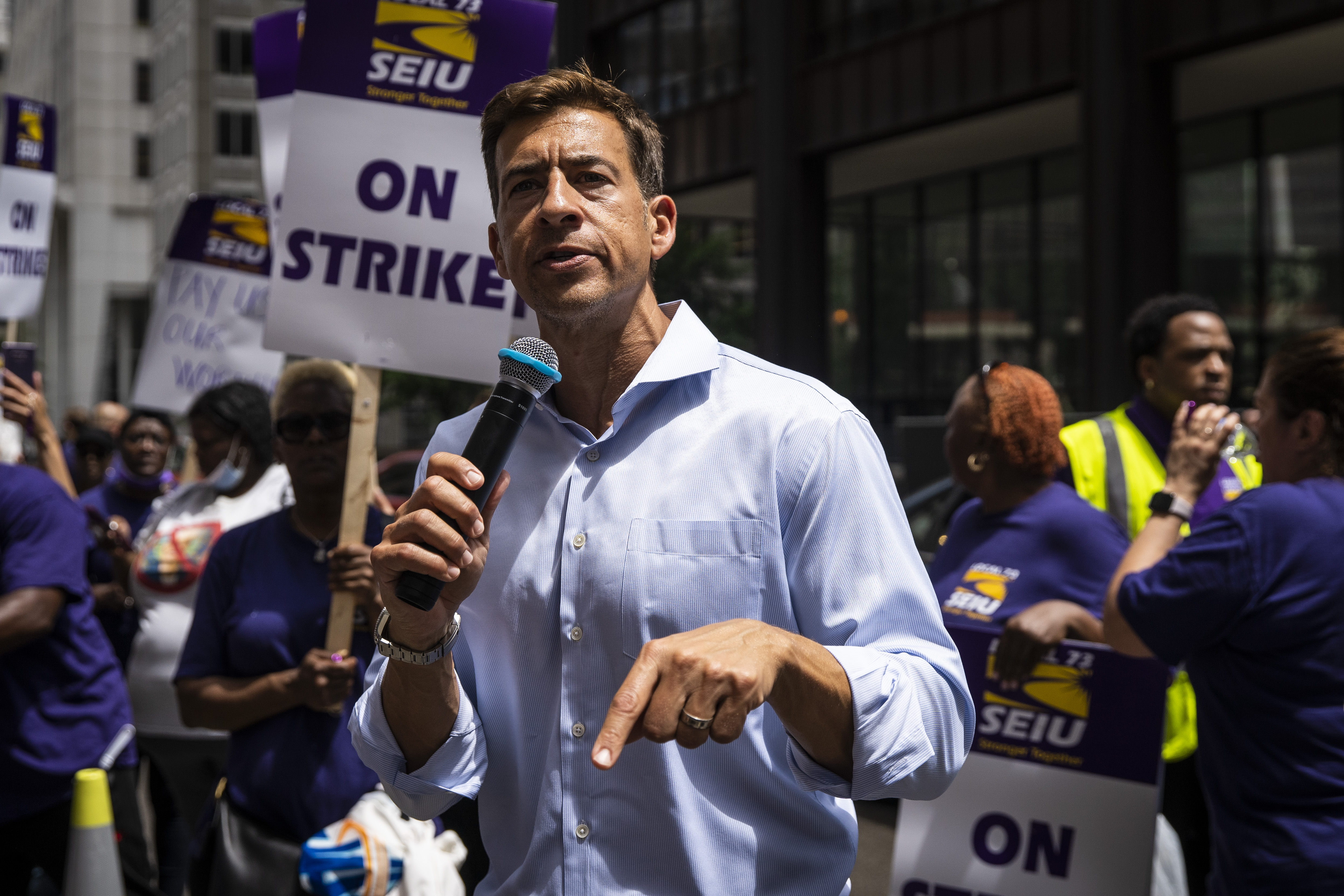 Democratic secretary of state candidate Alexi Giannoulias speaks to striking Cook County workers in June.