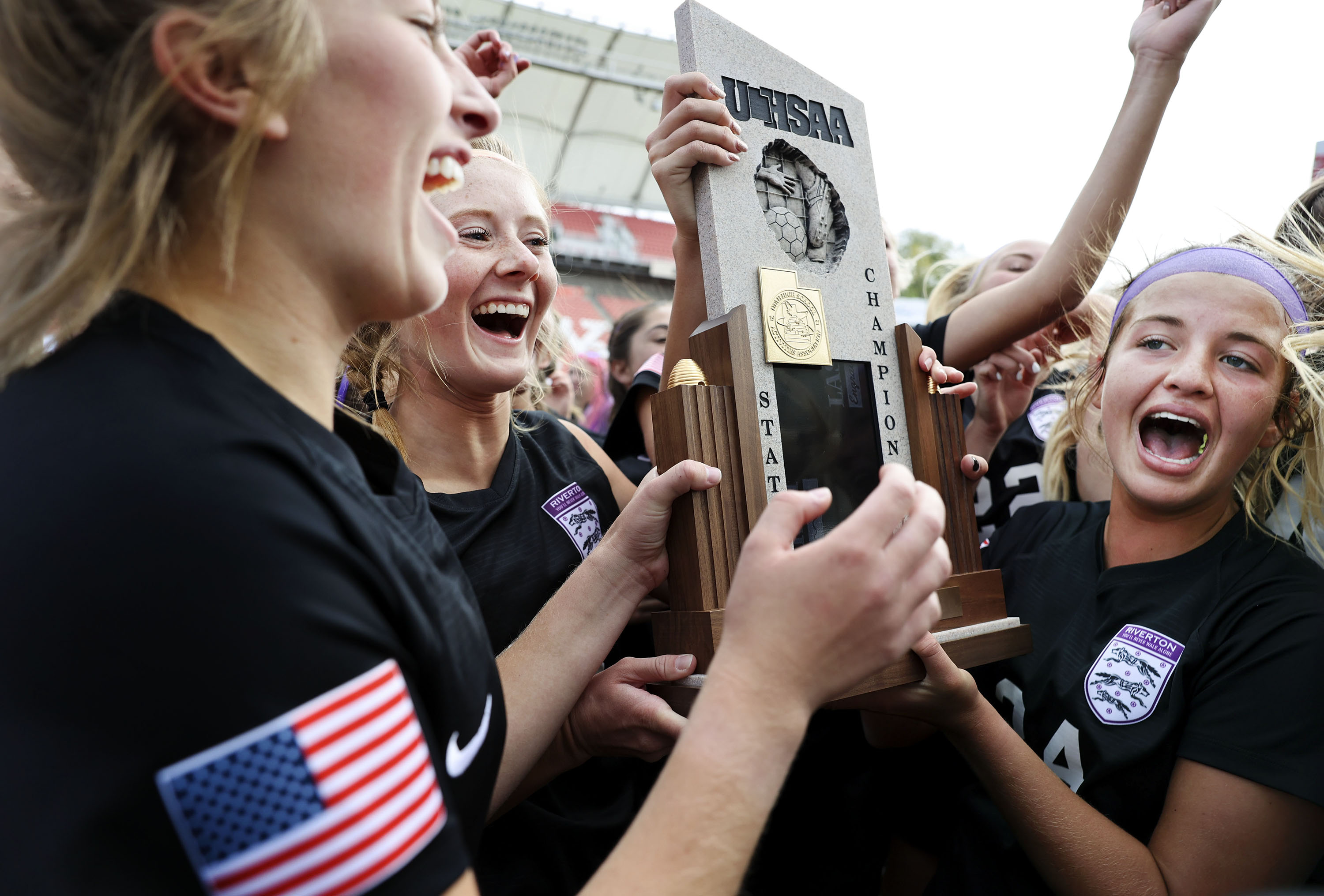 Riverton High School players celebrate their 6A girls soccer state championship win against Skyridge.