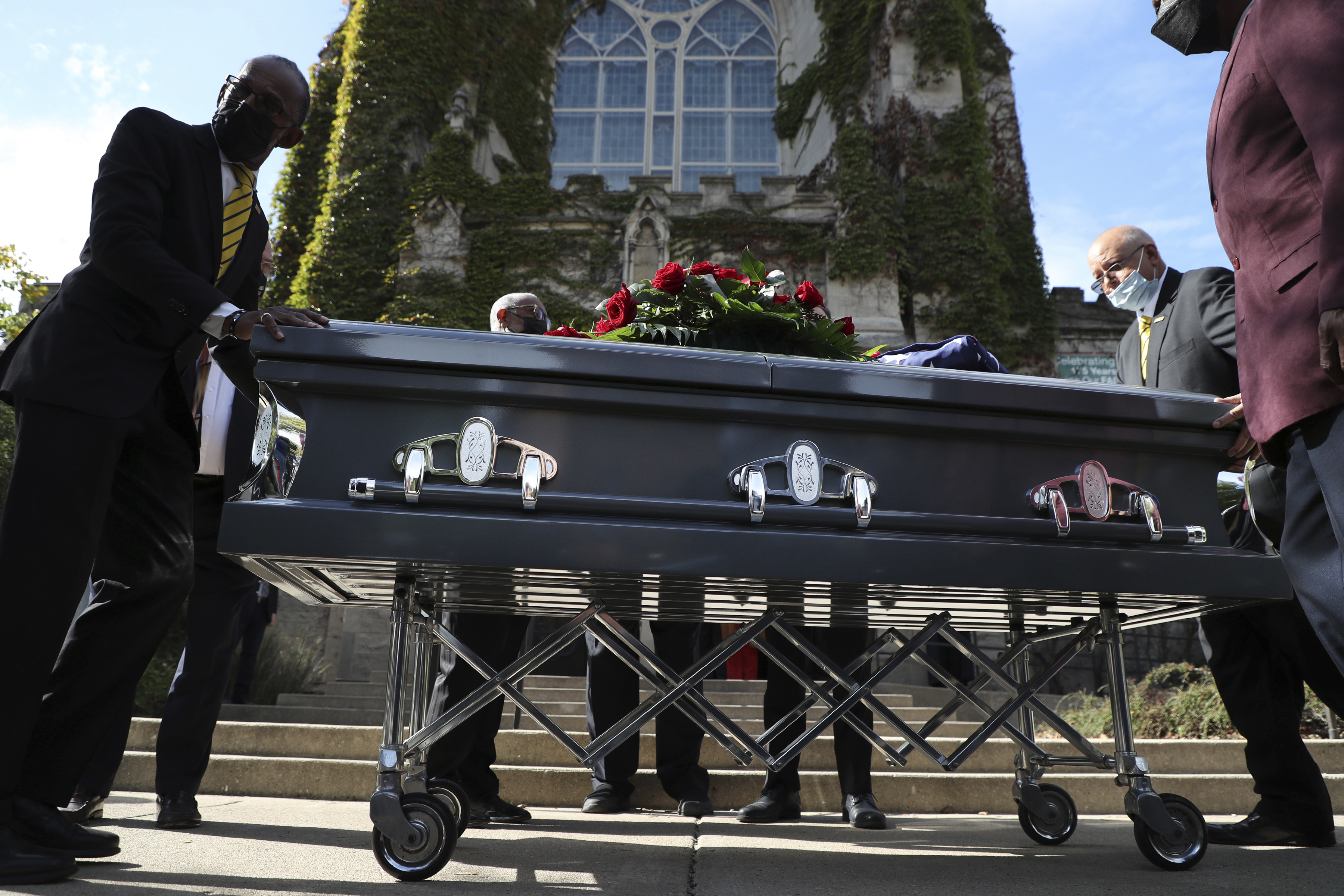 The casket bearing the remains of Timuel Black is wheeled to a hearse after funeral service at First Unitarian Church of Chicago on Friday, Oct. 22, 2021. The civil rights activist, retired Chicago professor and historian died Wednesday, Oct. 13, at the age of 102.