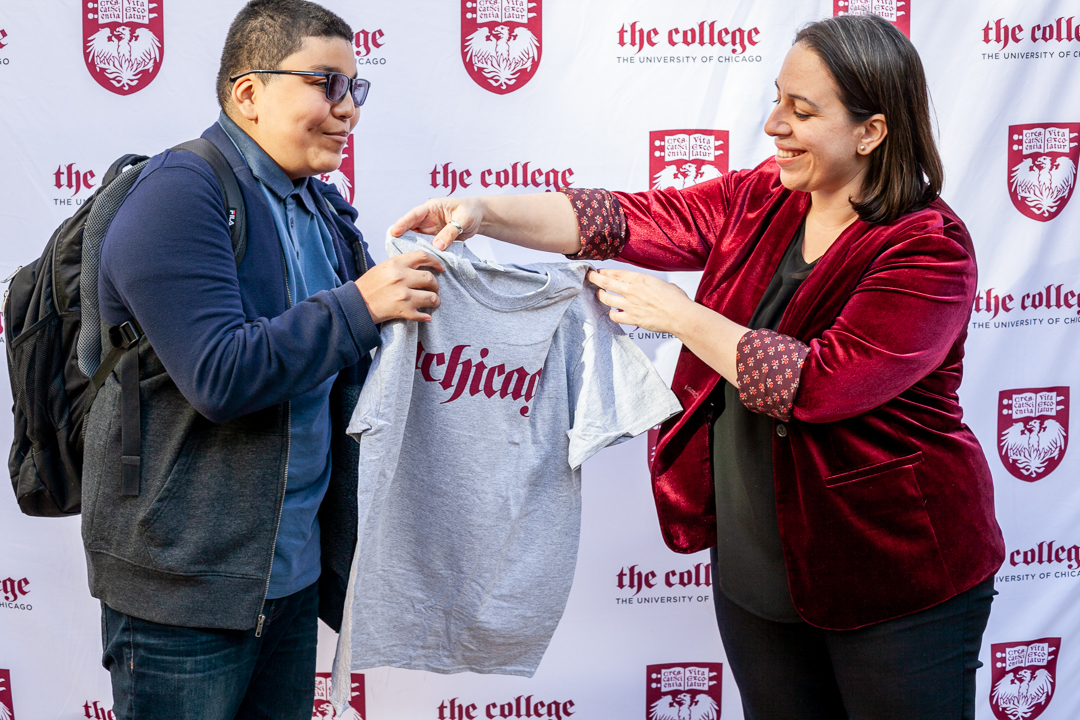 Lane Tech high school senior Anthony Alvarez Reyes (left) was surprised with an admission to University of Chicago on Friday. Lane Tech Senior Anthony Alvarez at a surprise ceremony finds out he is the first member of the University of Chicago's Class of 2026 on Friday, October 22, 2021 in Chicago, IL. Alvarez will receive a full-ride scholarship. Photography by Eddie Quinones.