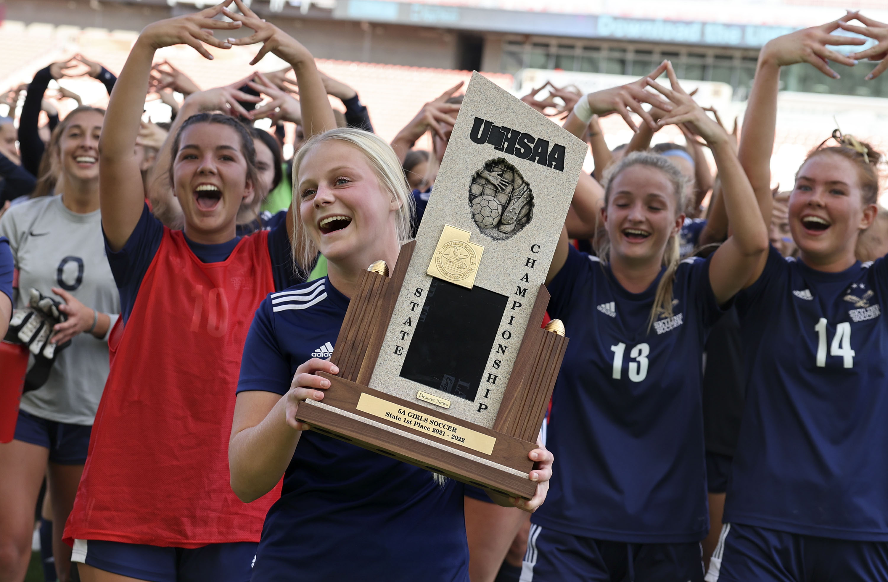Skyline players celebrate their win against Lehi in the 5A girls soccer championship.