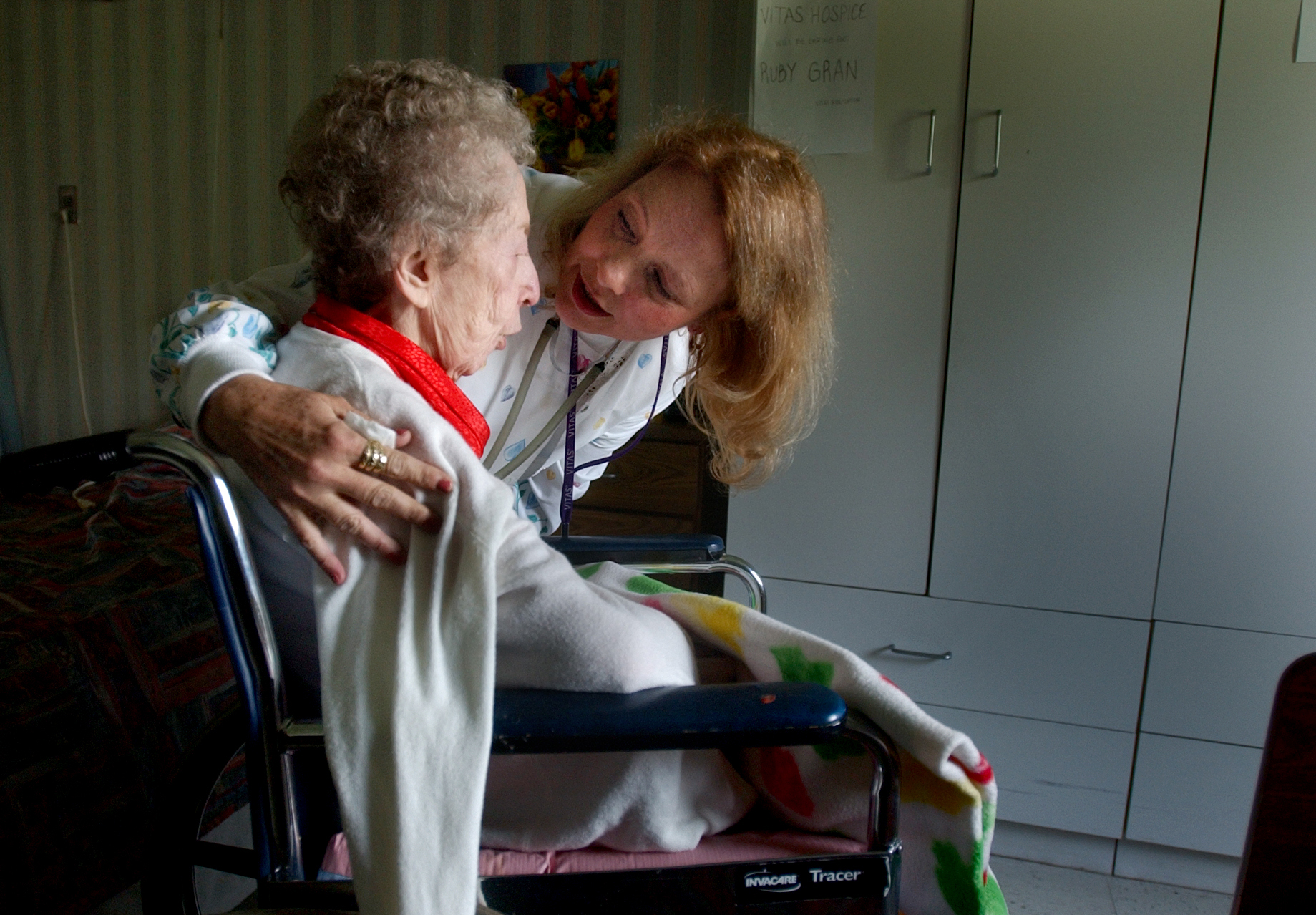 ROBERT SUMNER / HERALD NEWS STAFF PHOTOGRAPHER Hospice patient Ruby Gran gets a hug from her hospice nurse Donna Lyle at Rosewood Care Center in Joliet. Lyle works for Vitas Healthcare Corporation, which provides the hospice Service. 042105