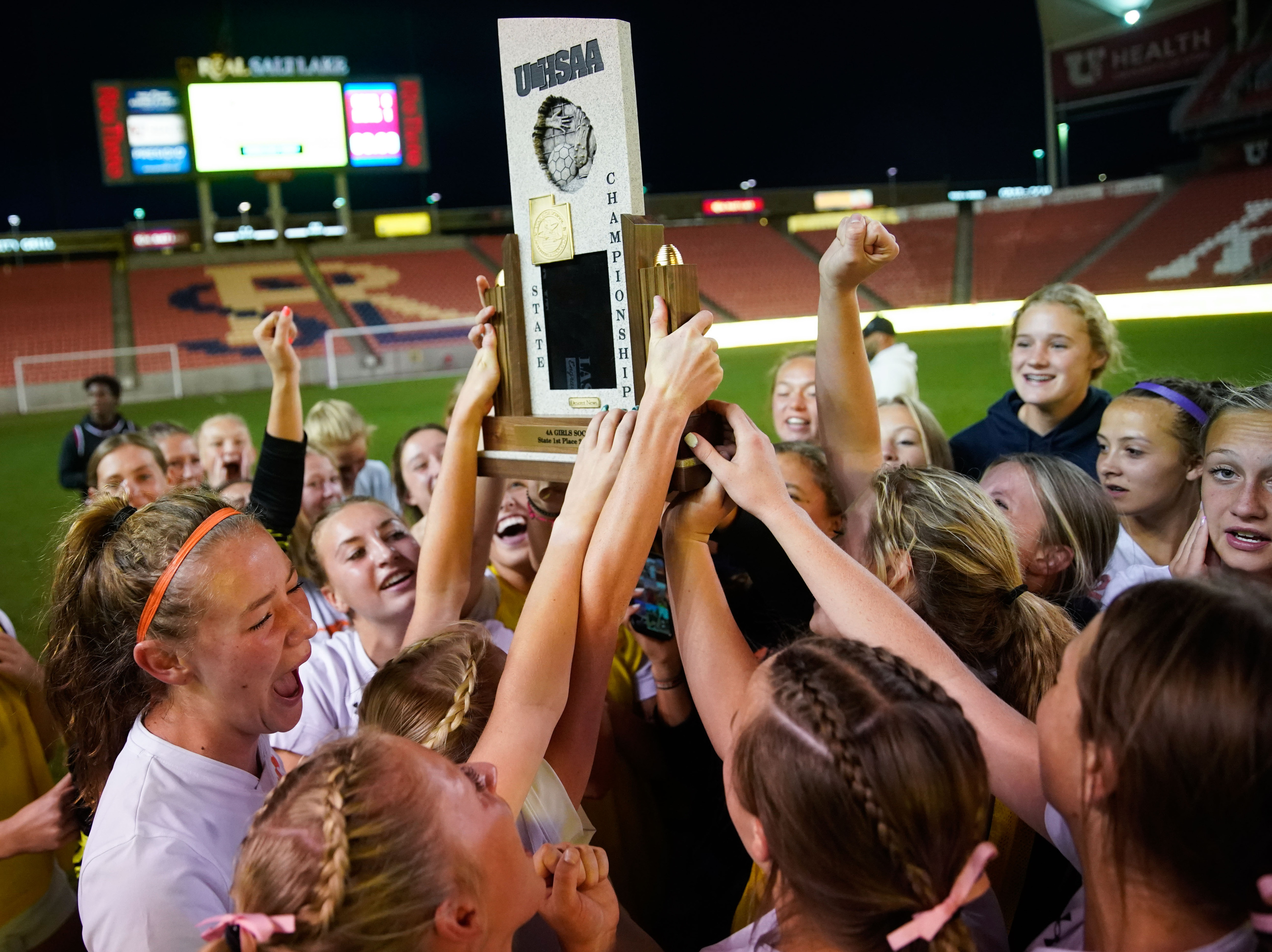 The Mountain Crest soccer team cheers after winning the 4A girls soccer state championship game against Crimson Cliffsat Rio Tinto Stadium in Sandy on Friday, Oct. 22, 2021.
