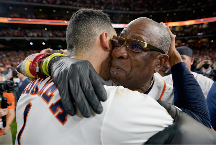Astros manager Dusty Baker and shortstop Carlos Correa celebrate their win against the Red Sox in Game 6. Baker returns to the World Series for the first time since 2002 with the Giants.