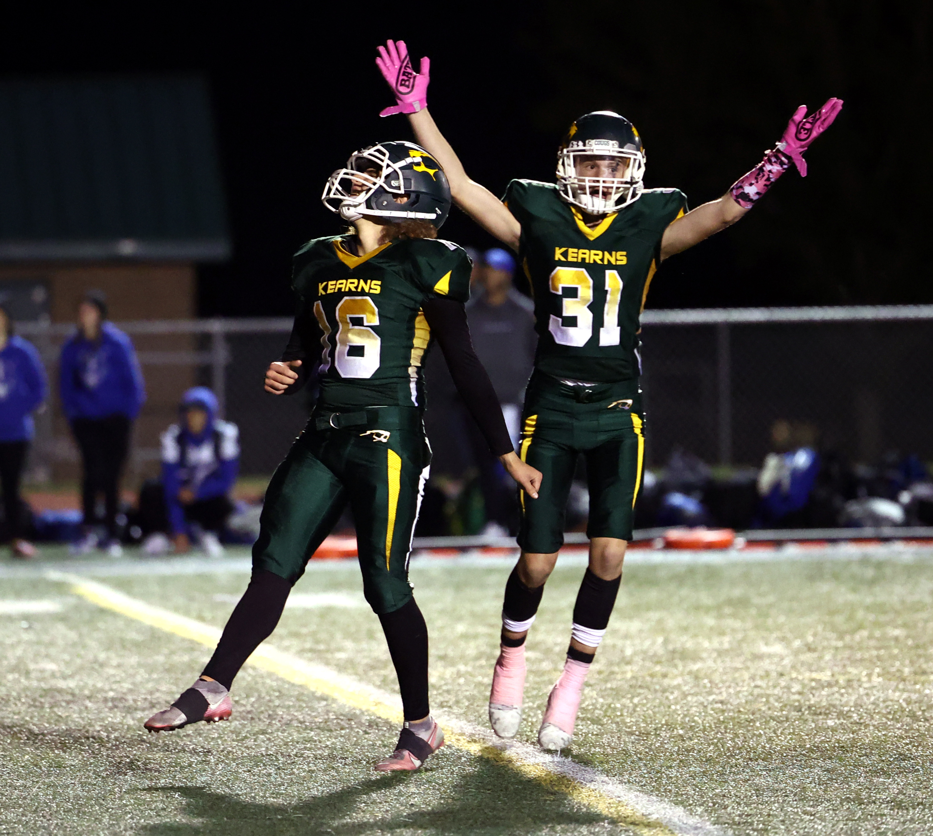 Kearns' kicker Benyon Glade watches as his kick sails through the uprights for the overtime win over Fremont as teammate Daniel Philip begins to celebrate.