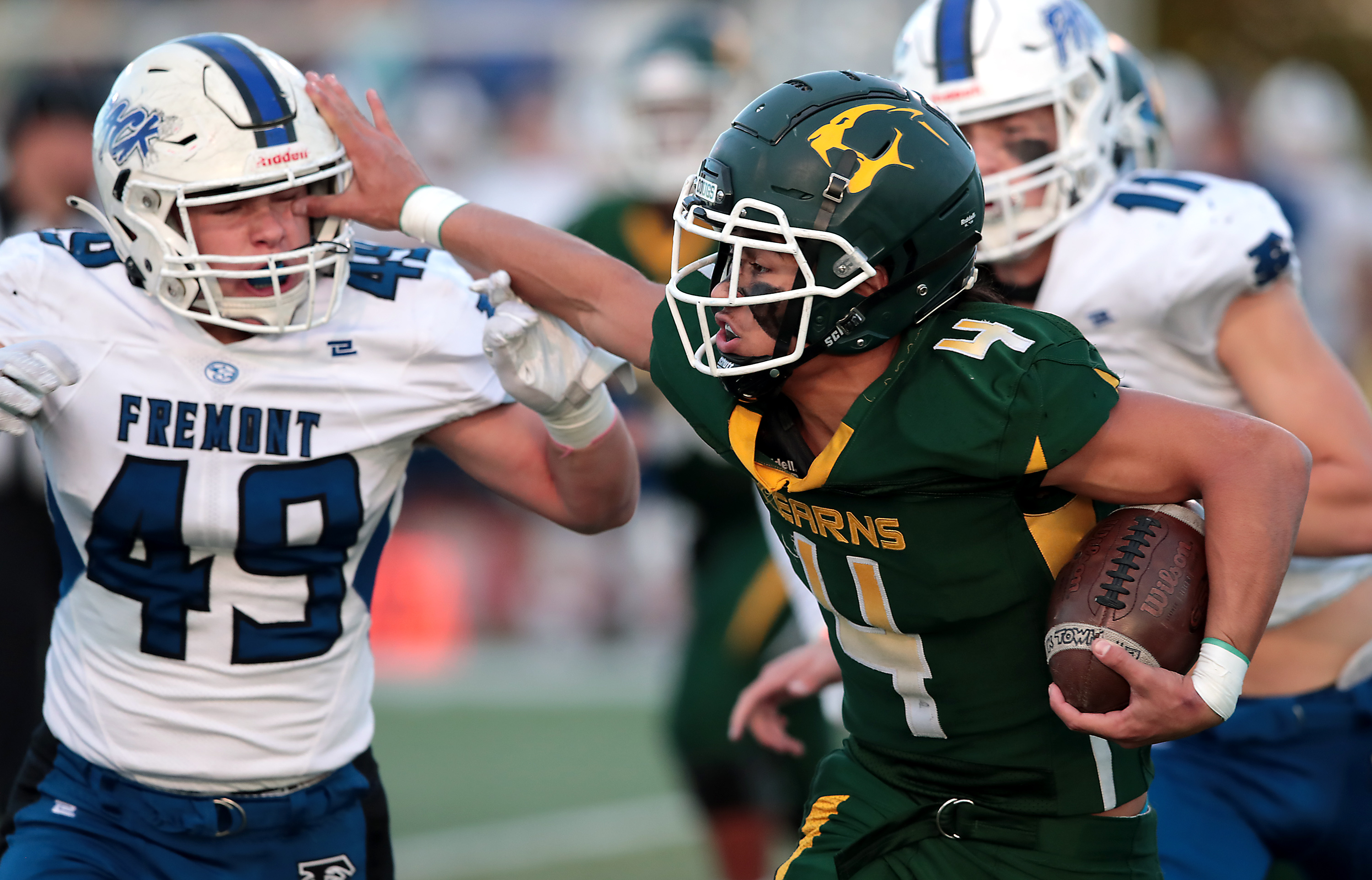 Kearns' quarterback Iosefa Toia'ivao stiff-arms Fremont's Brant Koford on a run during a 6A state playoff game at Kearns on Friday, Oct. 22, 2021. Kearns won 31-30 in overtime.