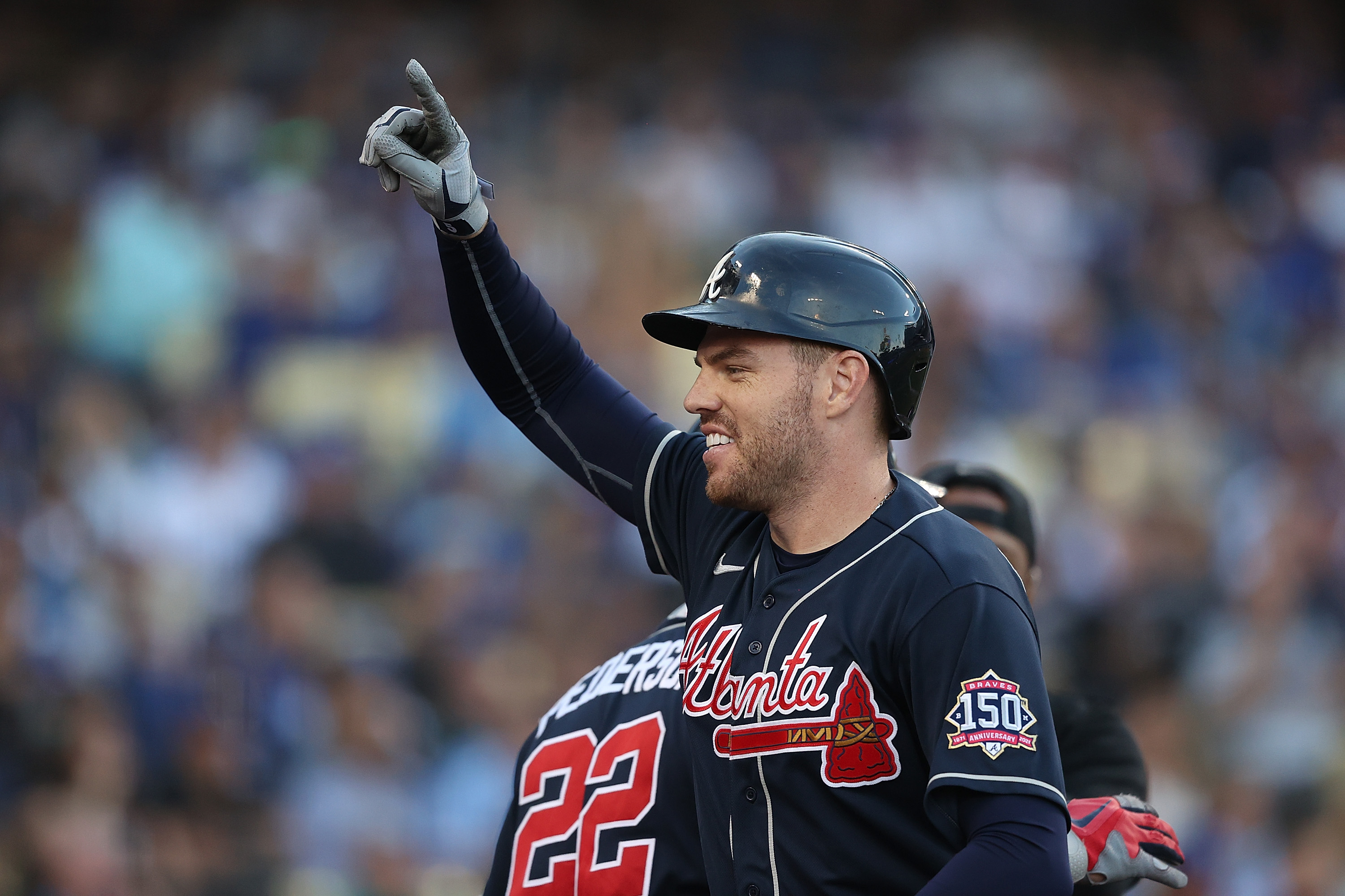 Freddie Freeman #5 of the Atlanta Braves celebrates a two run home run during the first inning of Game Five of the National League Championship Series against the Los Angeles Dodgers at Dodger Stadium on October 21, 2021 in Los Angeles, California.