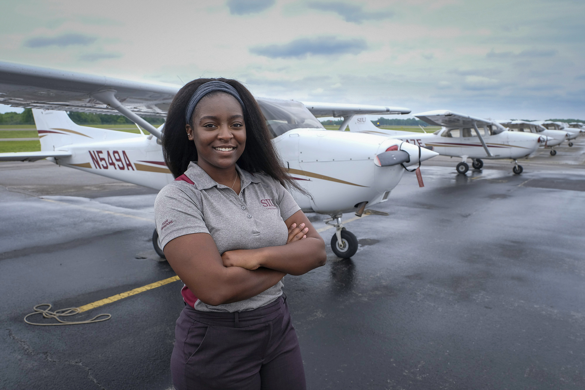 Vernecelyn Allen on the tarmac at the Southern Illinois Airport in Murphysboro, Ill. Allen, who completed majors in aviation management and aviation flight in May and August, just earned her flight instructor's certification.