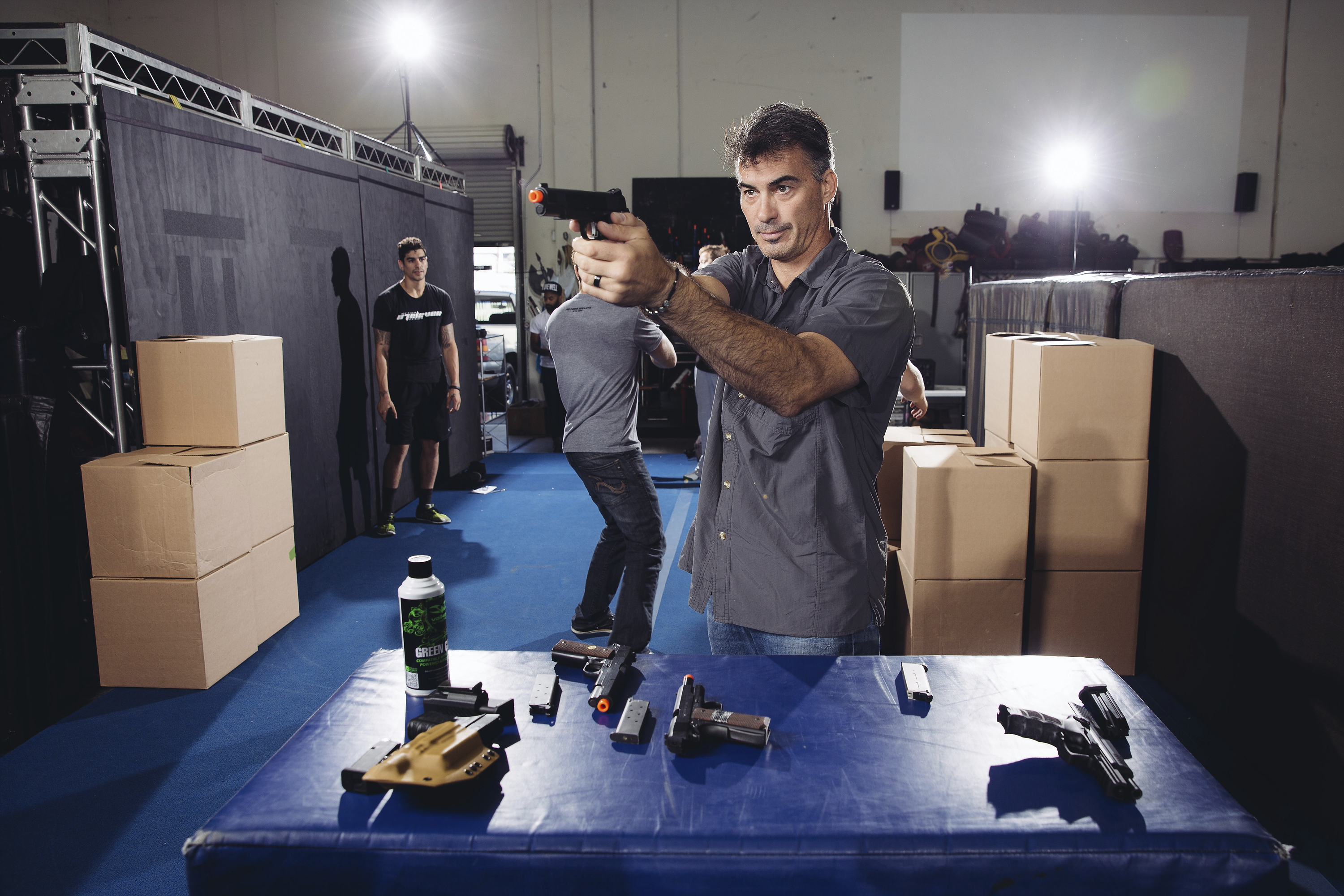 """Chad Stahelski, co-director of the film, """"John Wick,"""" demonstrates proper gun handling during a training session at 87Eleven Action Design in Inglewood, Calif.  in 2014"""