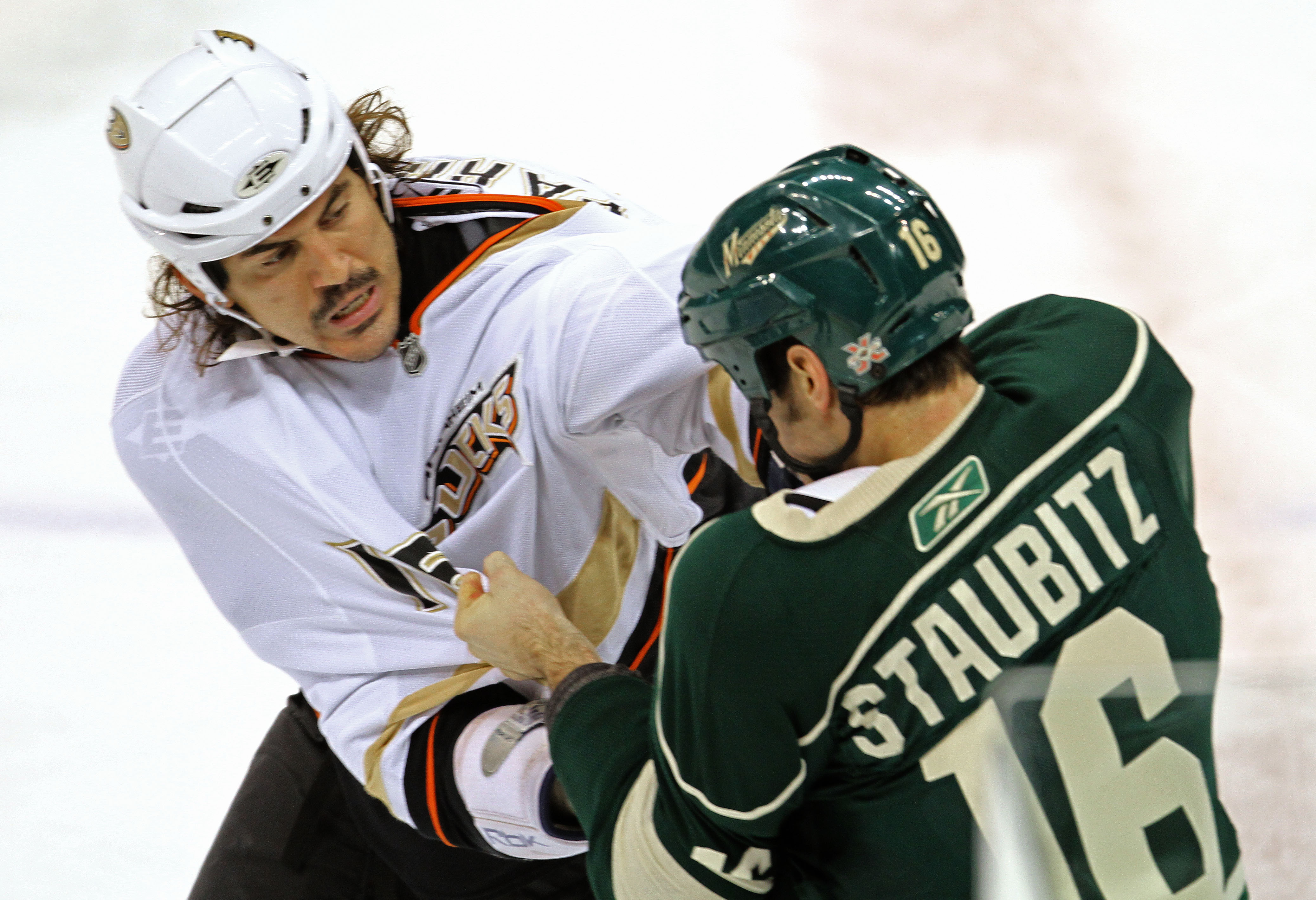 BRUCE BISPING ¥ bbisping@startribune.com St. Paul, MN., Wednesday, 11/17/10] Minnesota Wild vs Anaheim Ducks, (left to right) The Duck's George Parros and Wild's Brad Staubitz fought infront of the benches. Both received 5 minute majors for fighting