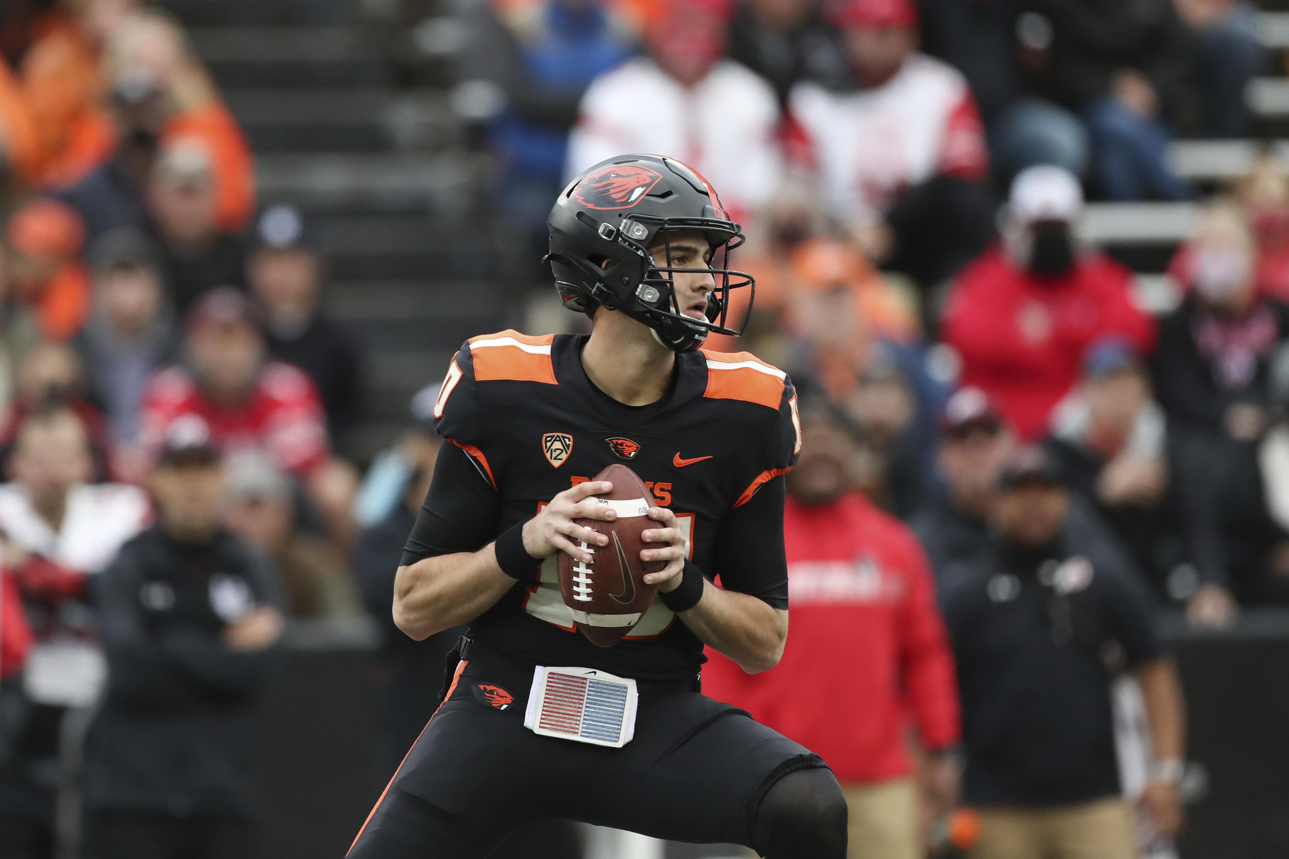 Oregon State quarterback Chance Nolan looks for a receiver
