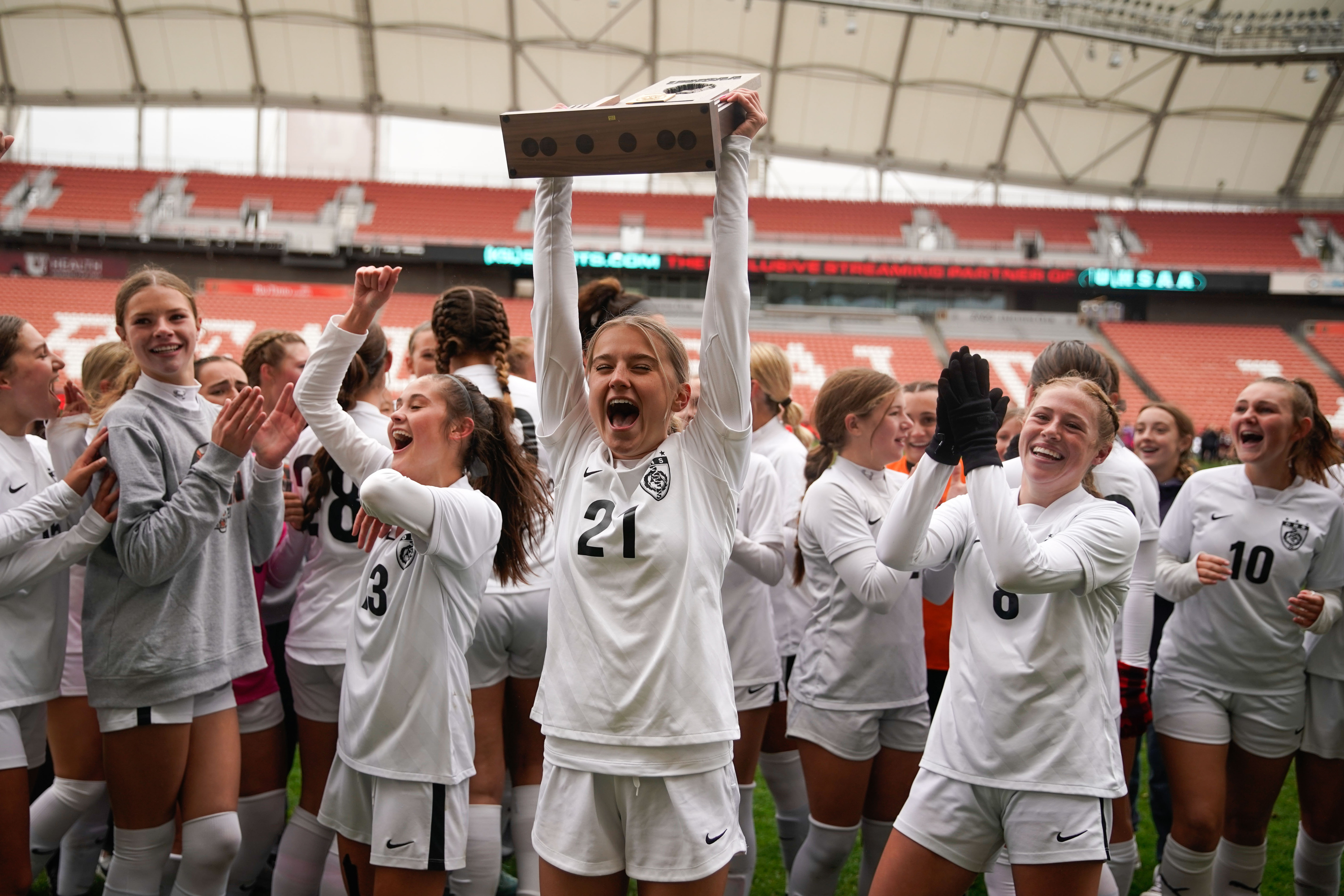 Ogden's Tess Bailey (21) and her teammates celebrate their win against Morgan High in the 3A girls soccer state championship game on Saturday, Oct. 23, 2021 at Rio Tinto Stadium in Sandy .