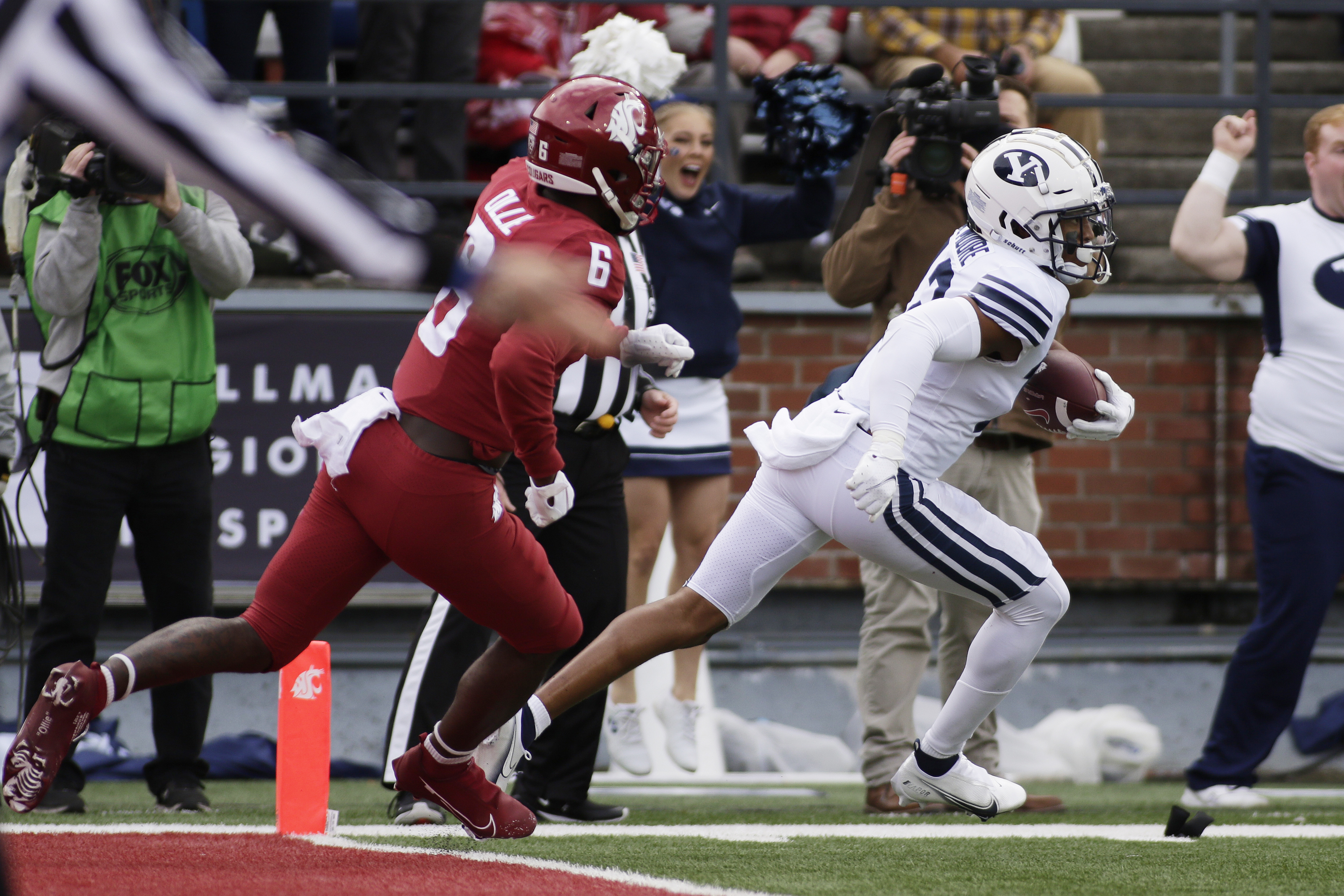 BYU defensive back Malik Moore, right, runs the interception he caught on a pass intended for Washington State wide receiver Donovan Ollie.