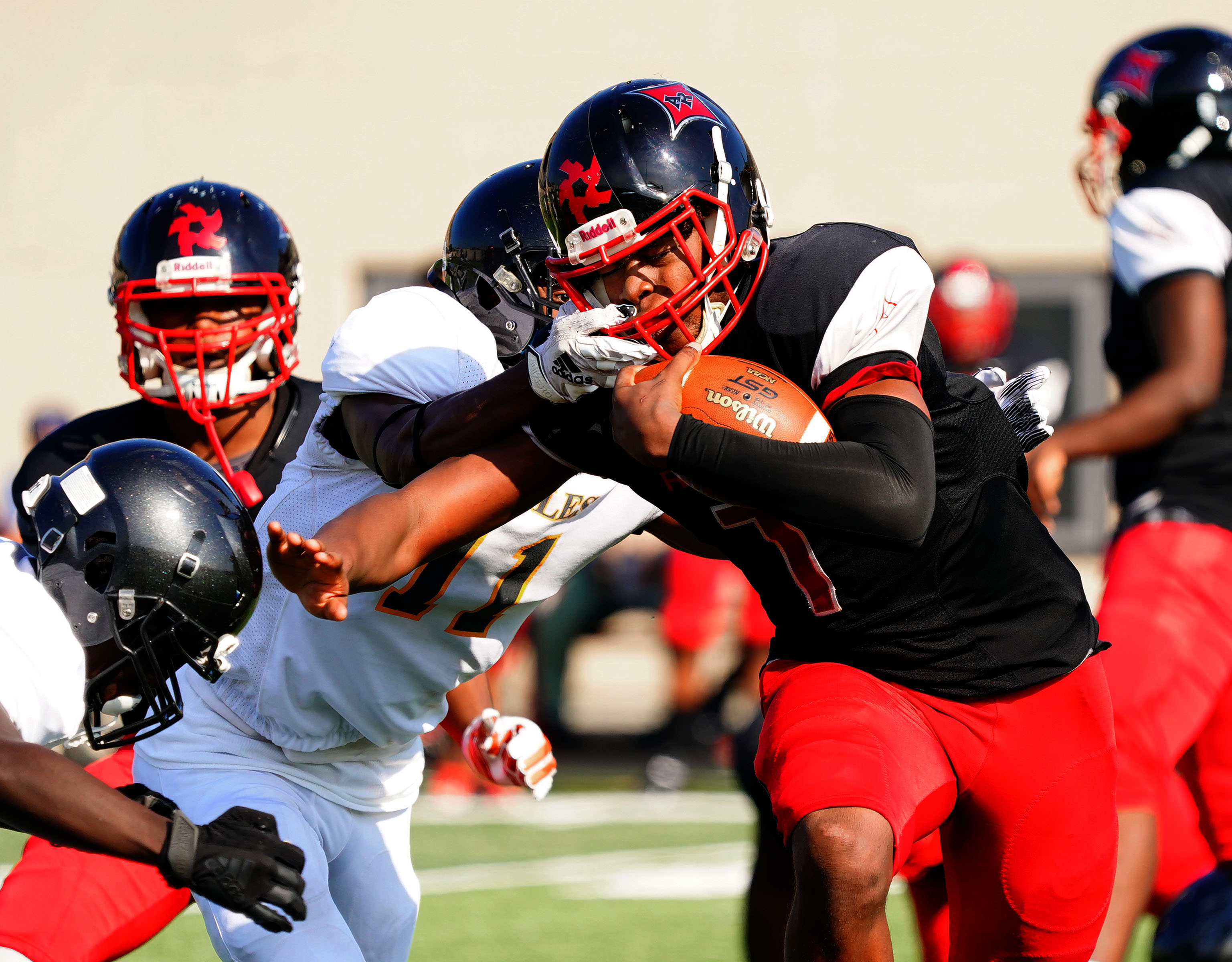 Raby's Jalen Monroe (7) is wrapped up by Clark's Jassani Freeman (11).
