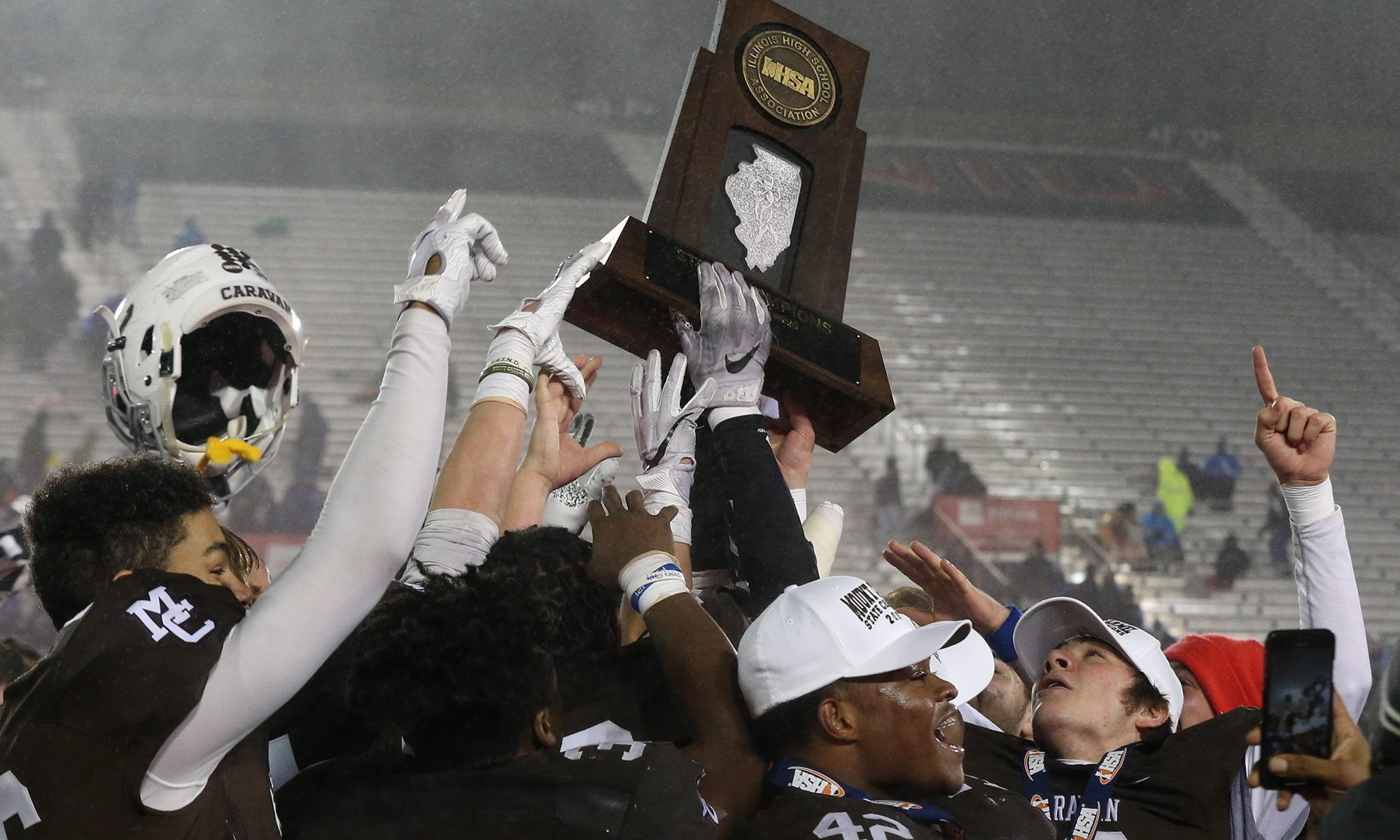 Mount Carmel's players celebrate their Class 7A State championship win over Nazareth in 2019.