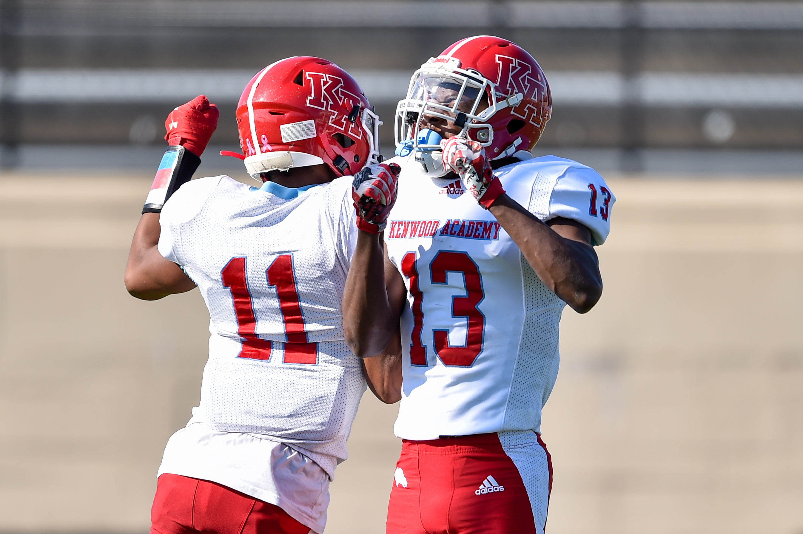 Kenwood's Kahlil Tate (11) and Omarion Lewis (13) celebrate Tate's touchdown against Simeon.