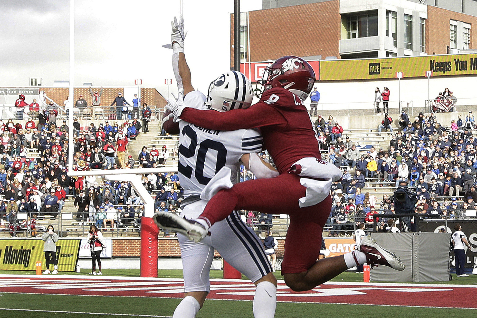 BYU defensive back Jacob Boren (20) disrupts a pass intended for Washington State wide receiver Calvin Jackson Jr.