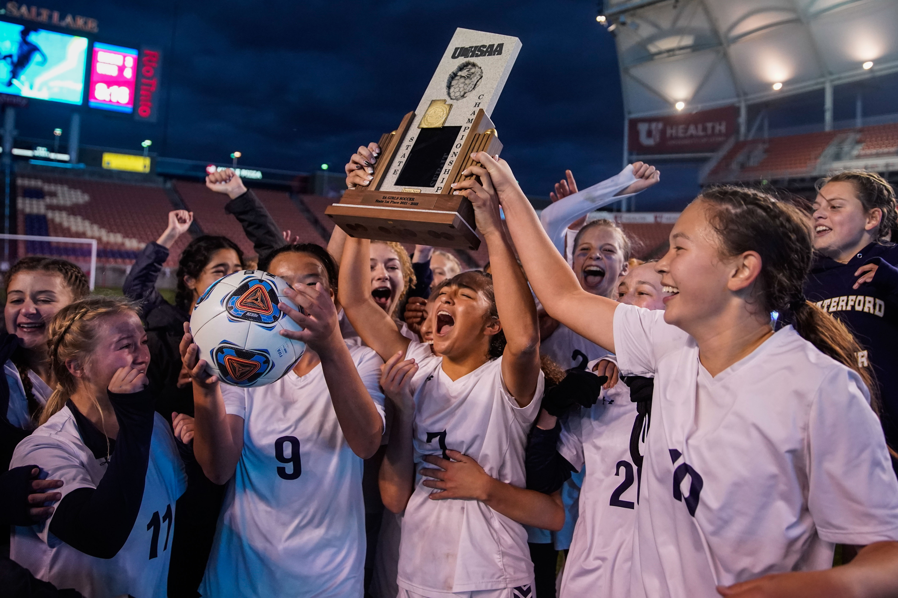 Waterford's Seven Castain, center, and her teammates celebrate their final goal against Rowland Hall High during the end of the second half of the 2A girls soccer state championship game on Saturday, Oct. 23, 2021 at Rio Tinto Stadium in Sandy .