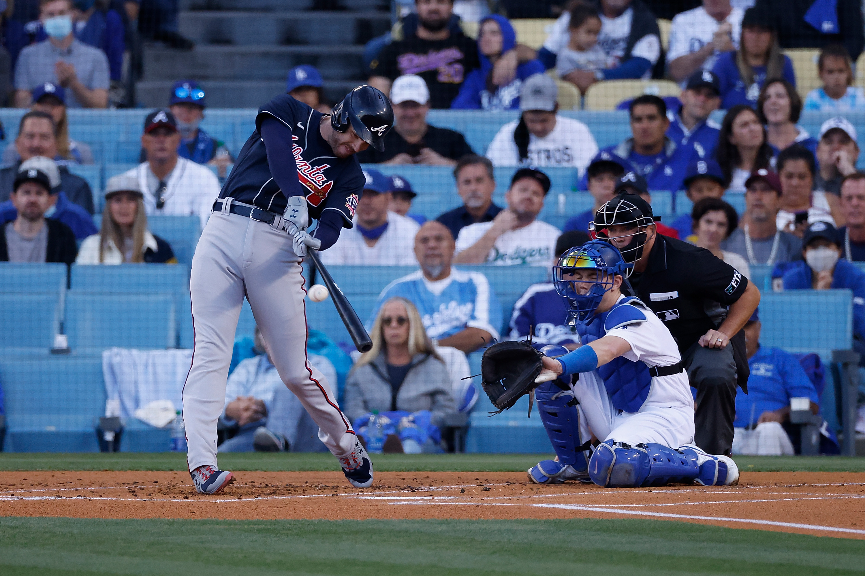 Freddie Freeman #5 of the Atlanta Braves hits a two run home run during the first inning of Game Five of the National League Championship Series against the Los Angeles Dodgers at Dodger Stadium on October 21, 2021 in Los Angeles, California.