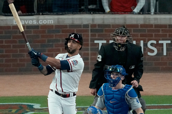 Left fielder Eddie Rosario belts a three-run homer off Dodgers starter Walker Buehler in the fourth inning to give the Braves a 4-1 lead in Game 6.
