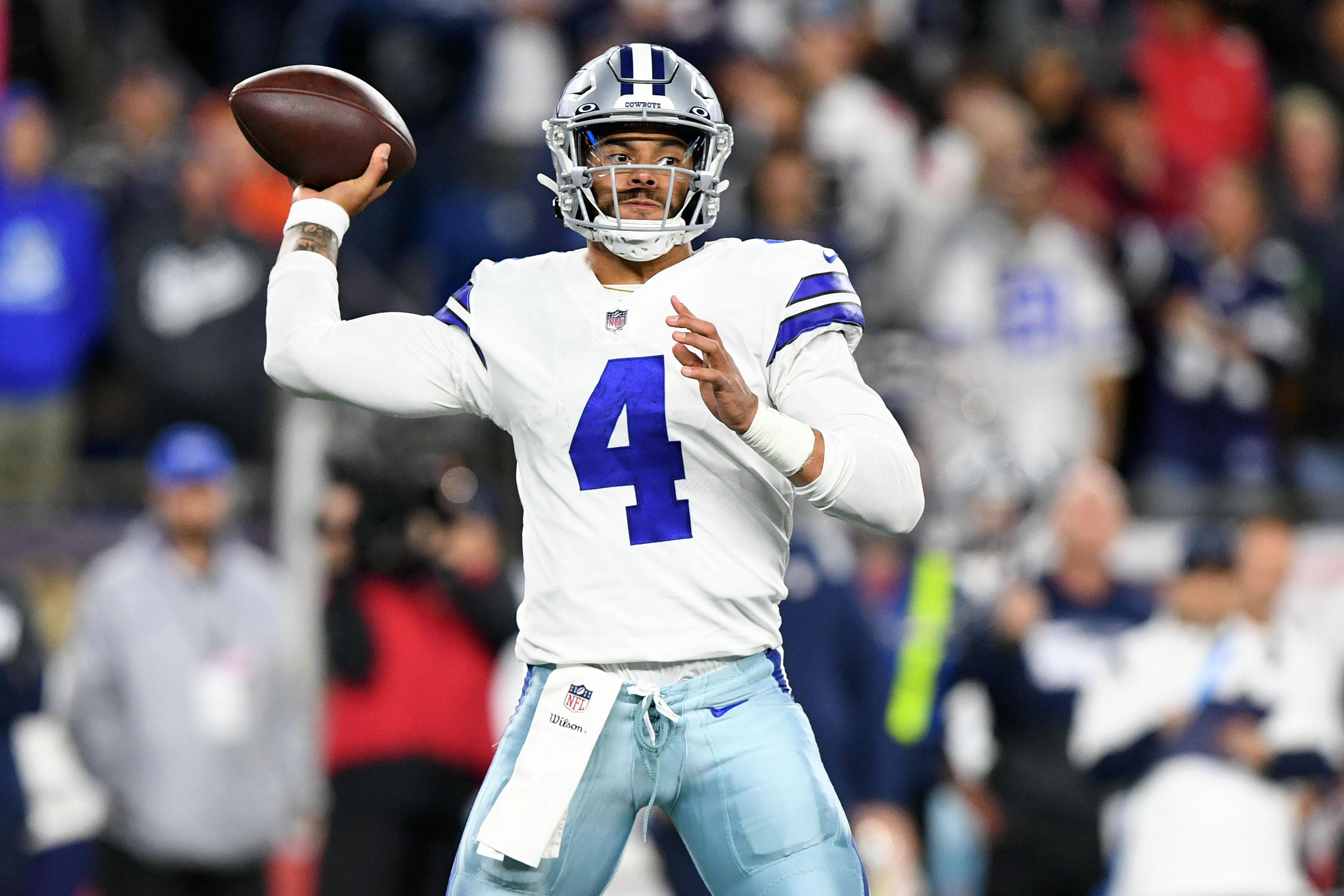 Dallas Cowboys quarterback Dak Prescott (4) passes the ball against the New England Patriots during the second half at Gillette Stadium.