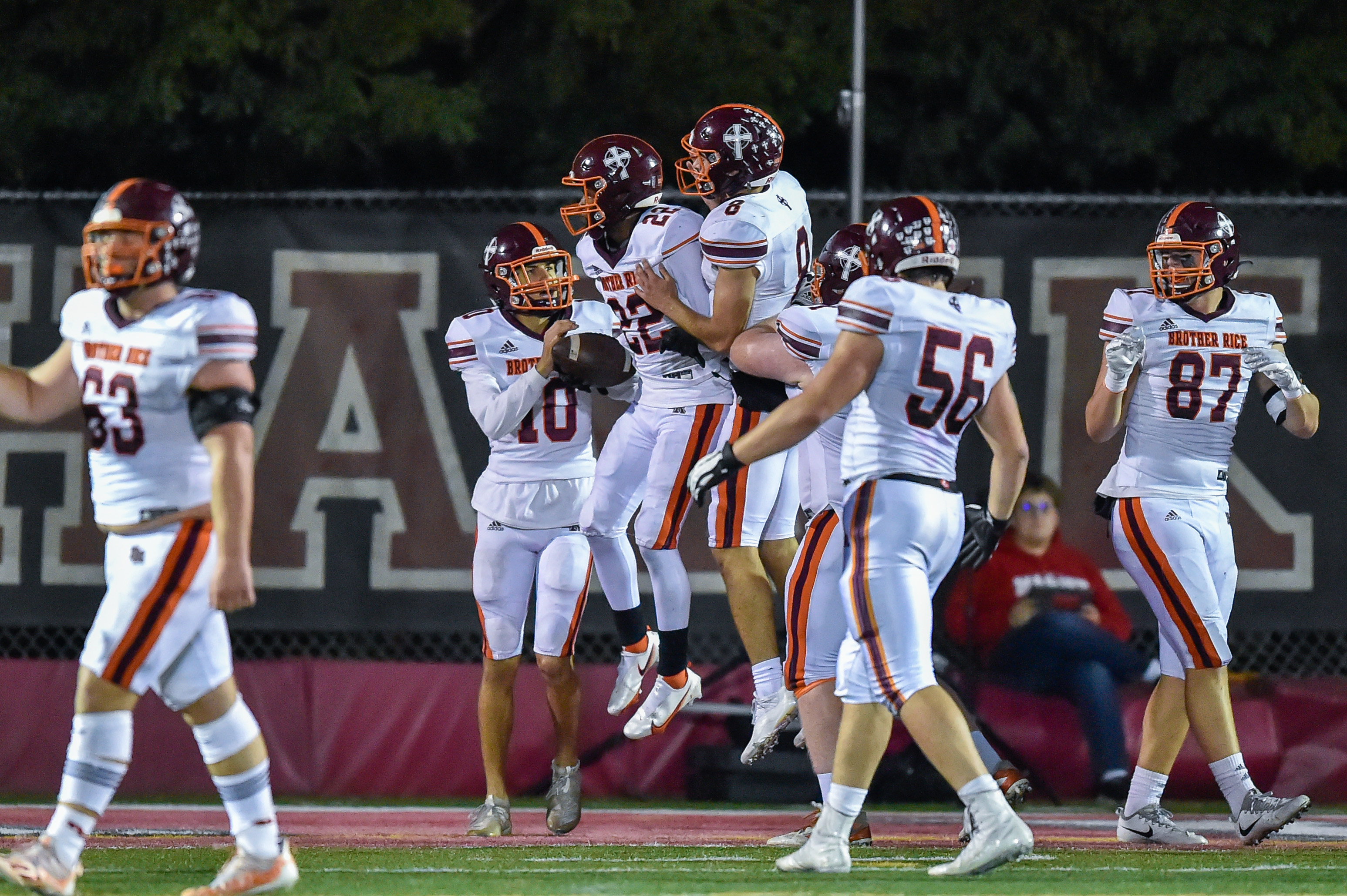 Brother Rice's Jack Lausch (8) and Luke Niksic (22) celebrate Niksic's touchdown against Marist.