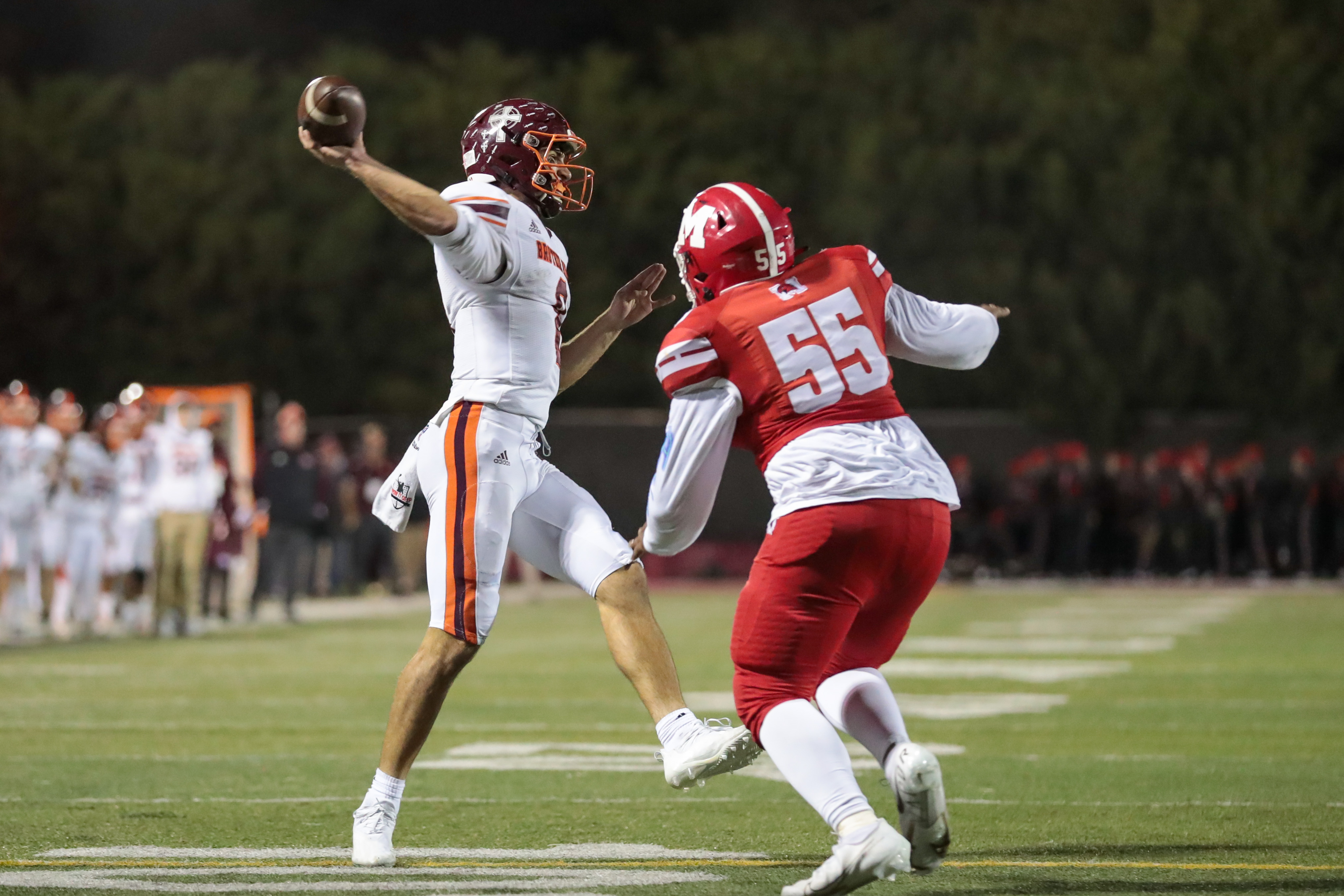 Brother Rice's Jack Lausch (8) throws a pass in the end zone to for the two-point conversion against Marist.