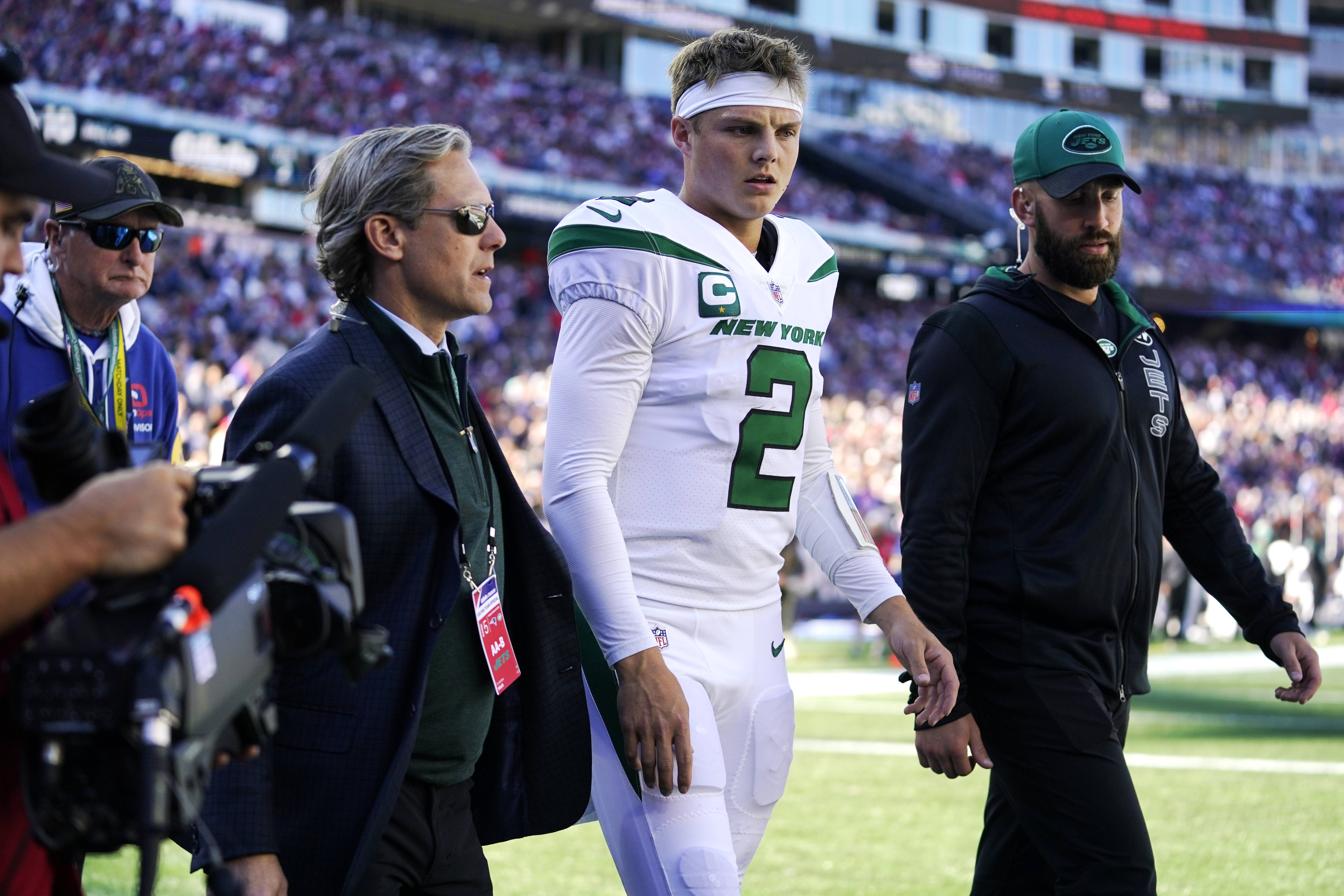 New York Jets quarterback Zach Wilson (2) is escorted to the locker room after an apparent injury.