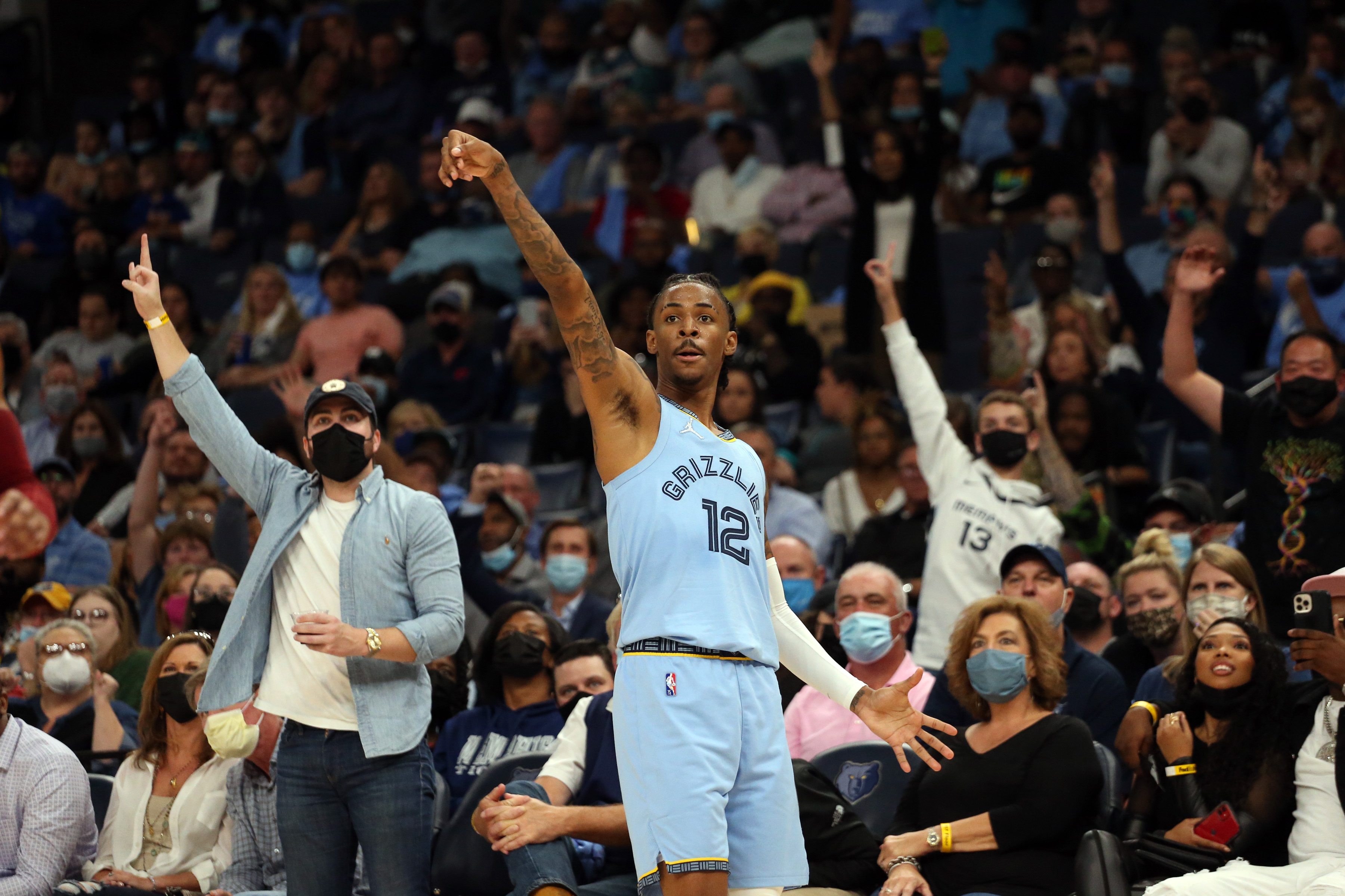 Memphis Grizzles guard Ja Morant (12) reacts after shooting a three point basket against the Cleveland Cavaliers during the second half at FedExForum.
