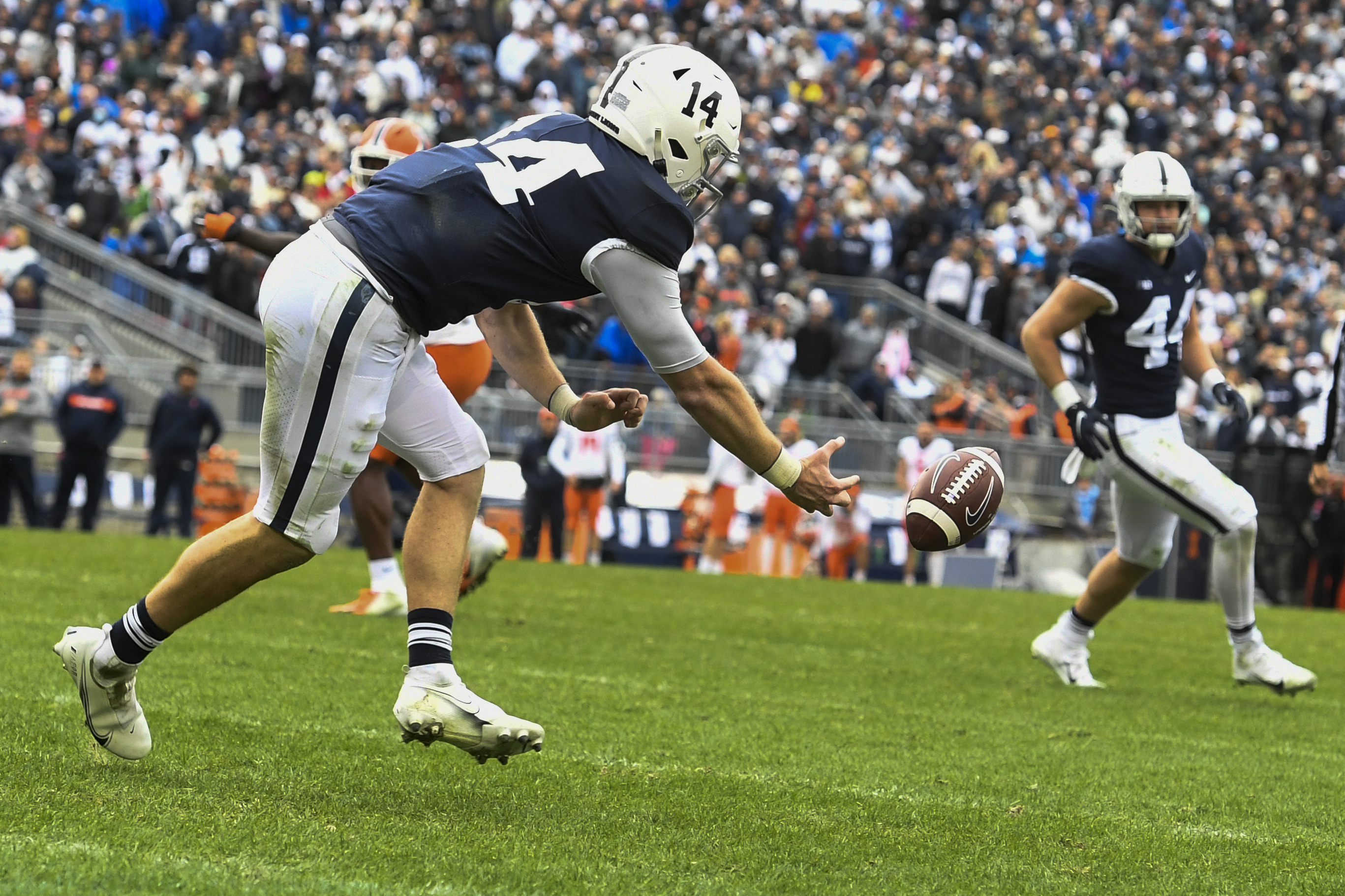 Penn State quarterback Sean Clifford (14) reaches for an incomplete pass from tight end Tyler Warren (44) in the third overtime of Saturday's loss to Illinois.