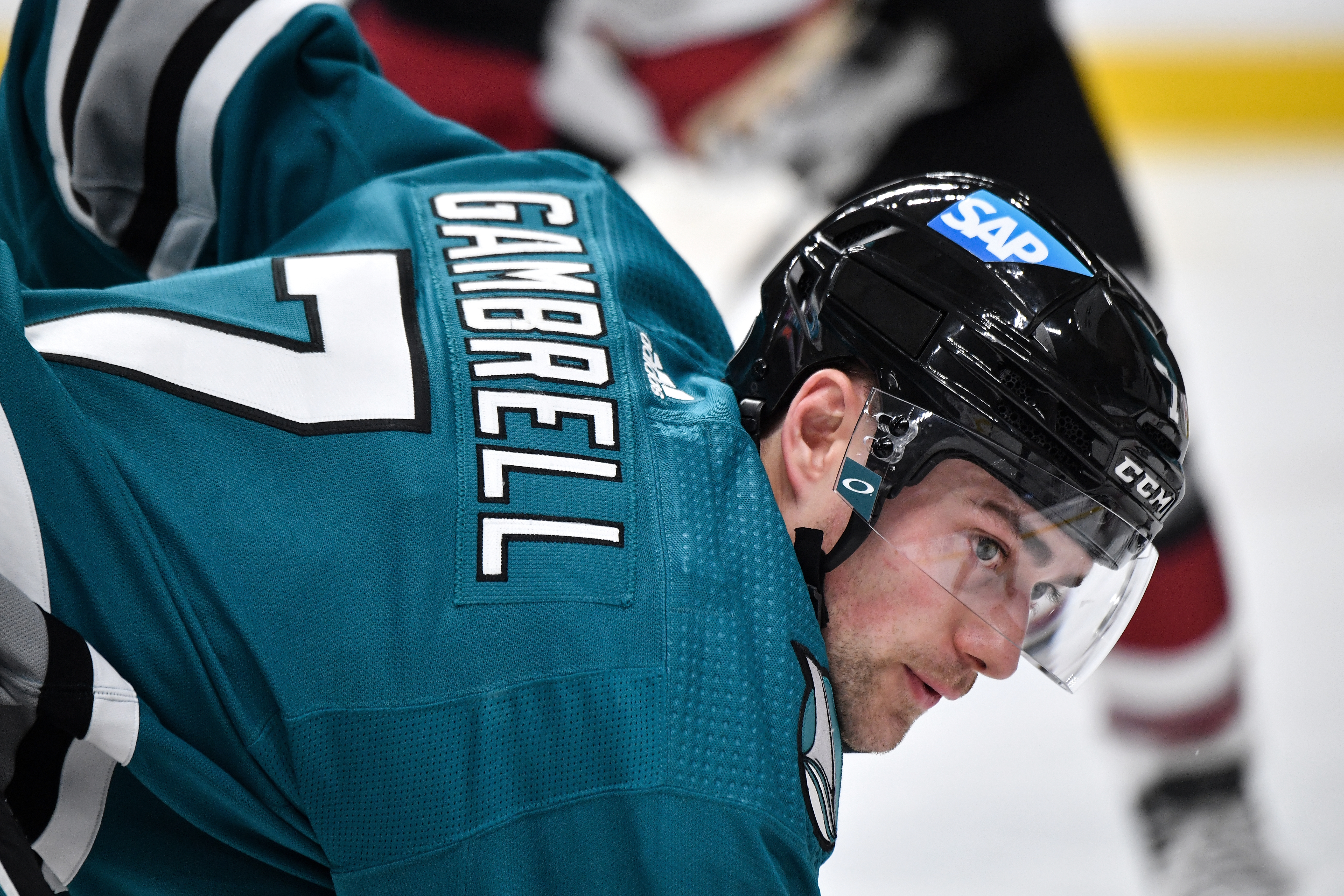 Dylan Gambrell #7 of the San Jose Sharks takes a face-off against the Arizona Coyotes at SAP Center on April 26, 2021 in San Jose, California.
