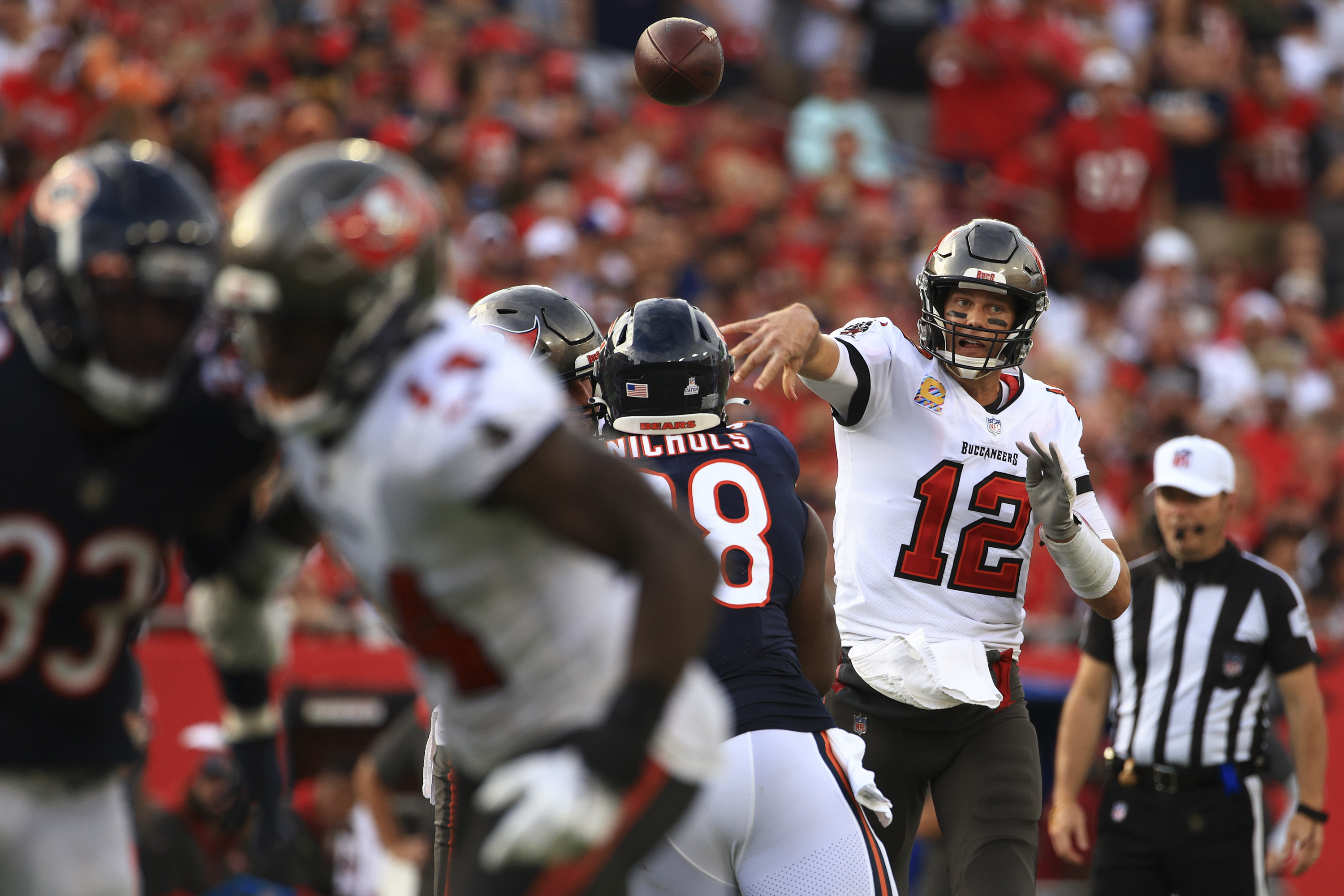 Buccaneers quarterback Tom Brady completes a pass against the Bears on Sunday.