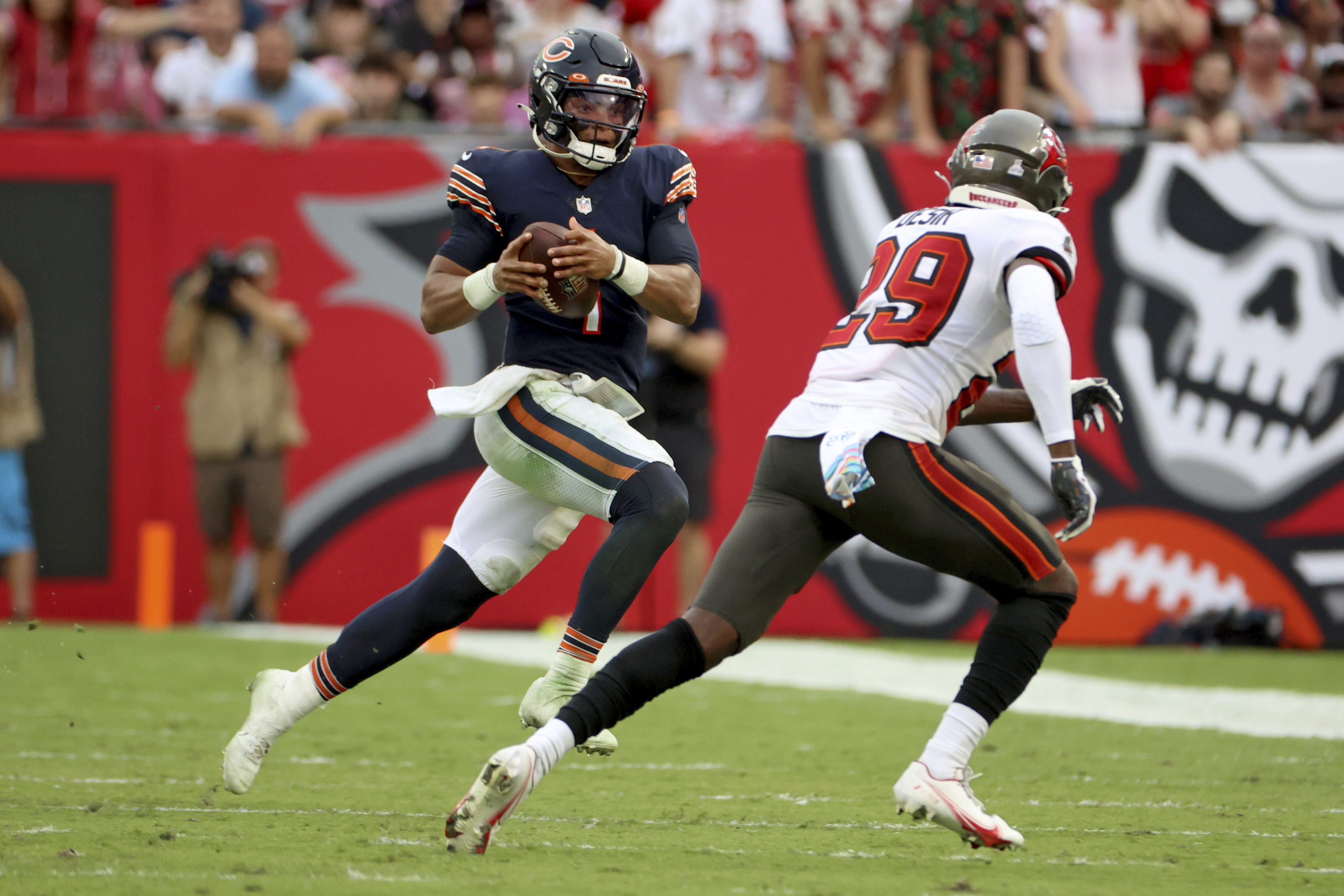 Bears rookie quarterback Justin Fields was sacked four times, fumbled three times — losing two — and threw three interceptions in a 38-3 loss to the Buccaneers on Sunday at Raymond James Stadium in Tampa, Fla.