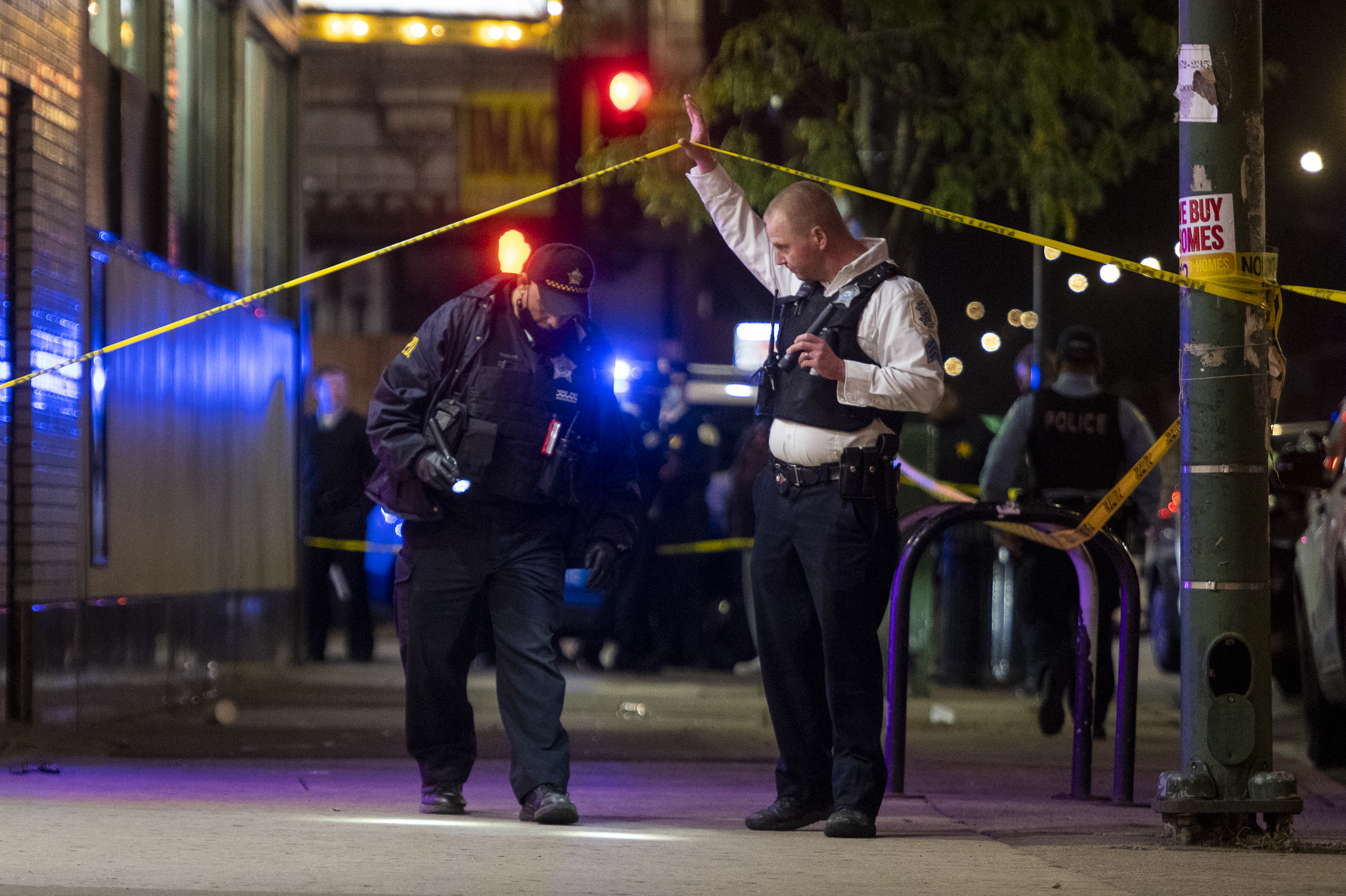 Chicago police work the scene where multiple people were shot in the 7900 block of South Cottage Grove Avenue, in the Chatham neighborhood, Friday, Oct. 22, 2021. | Tyler LaRiviere/Sun-Times
