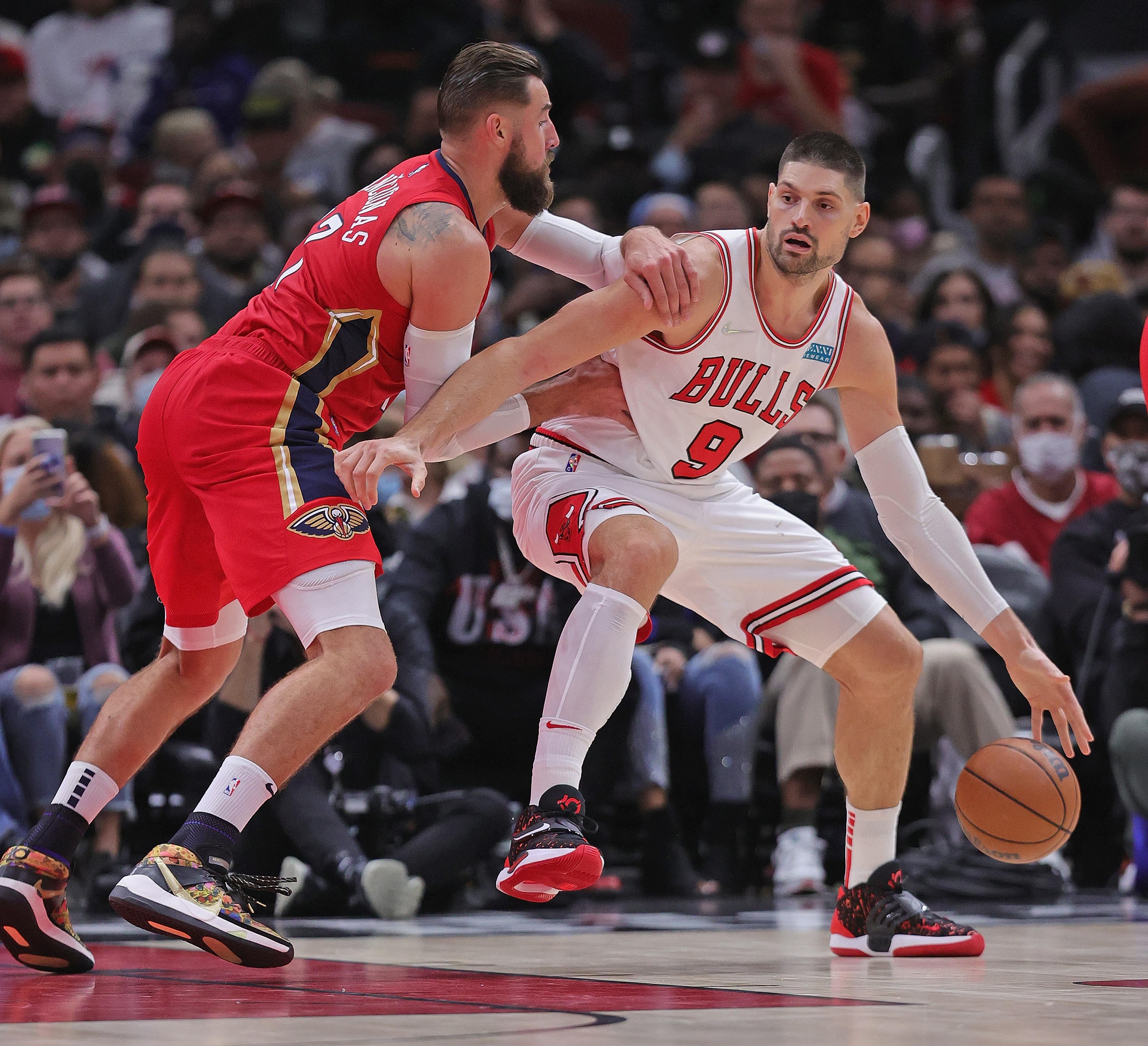 Nikola Vucevic #9 of the Chicago Bulls drives against Jonas Valanciunas #17 of the New Orleans Pelicans at the United Center on October 22, 2021 in Chicago, Illinois. The Bulls defeated the Pelicans 128-112.