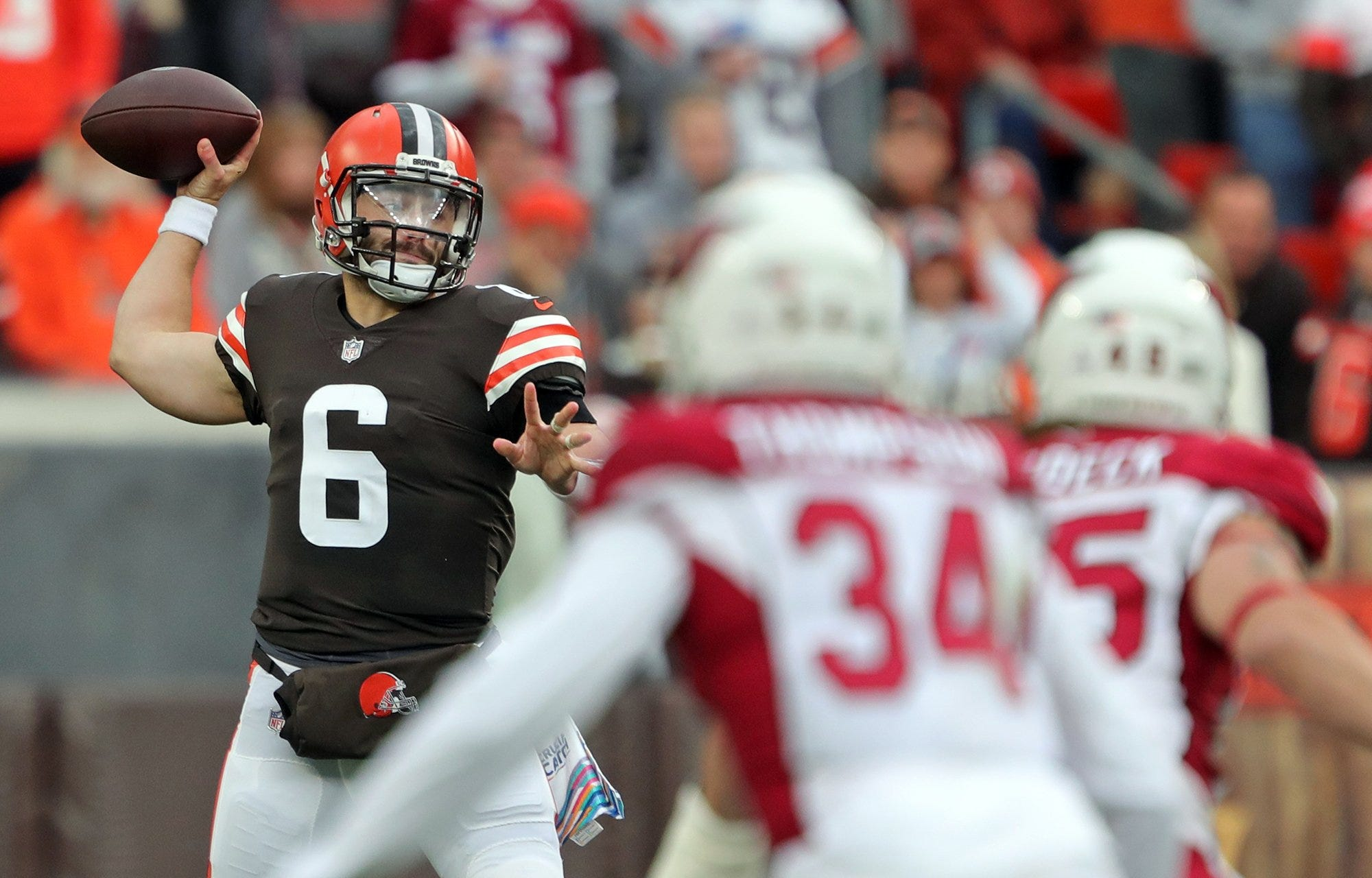 Cleveland Browns quarterback Baker Mayfield (6) looks to make a pass during the first half of an NFL football game against the Arizona Cardinals at FirstEnergy Stadium, Sunday, Oct. 17, 2021, in Cleveland, Ohio.