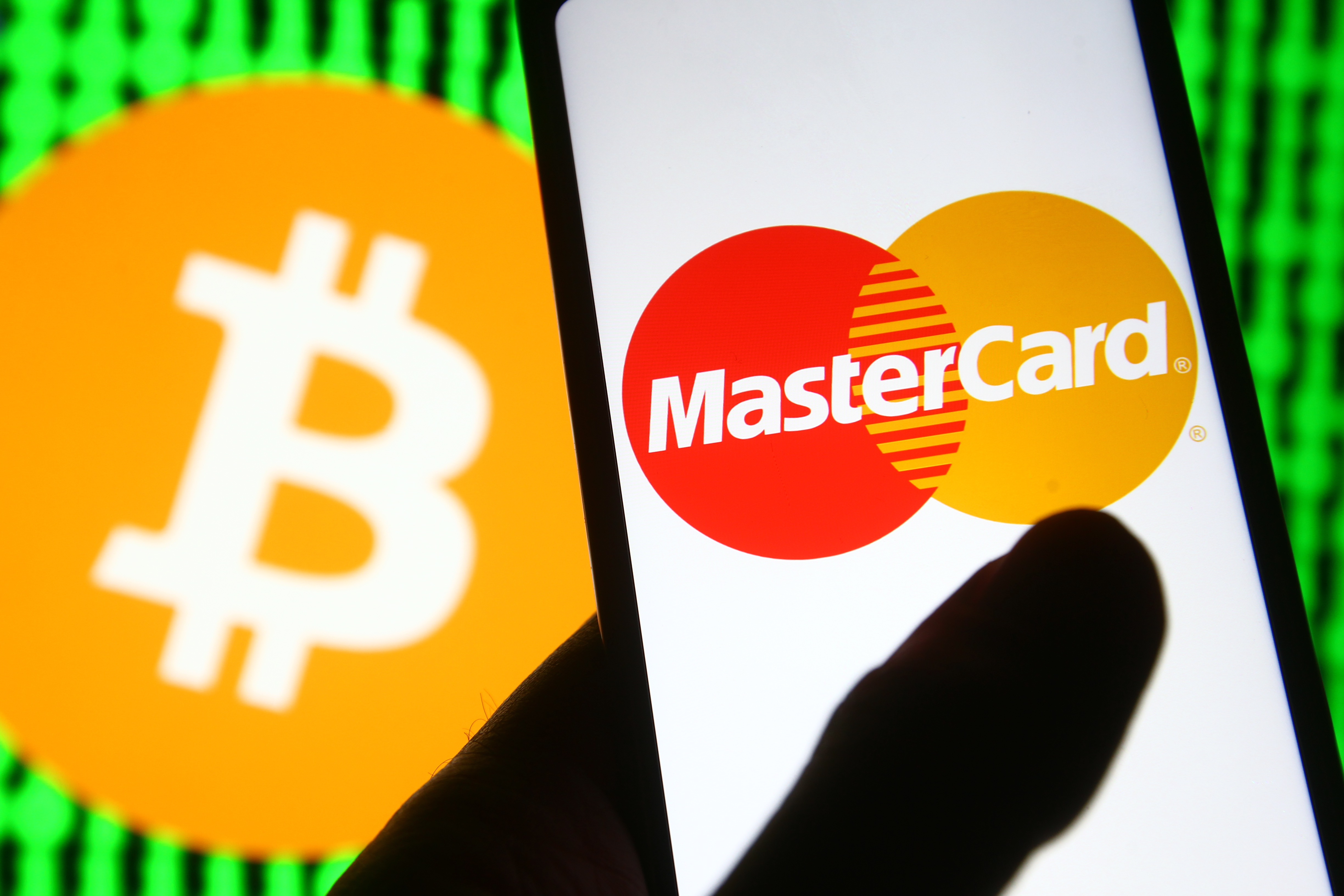 In this photo illustration a Mastercard logo is seen on a...