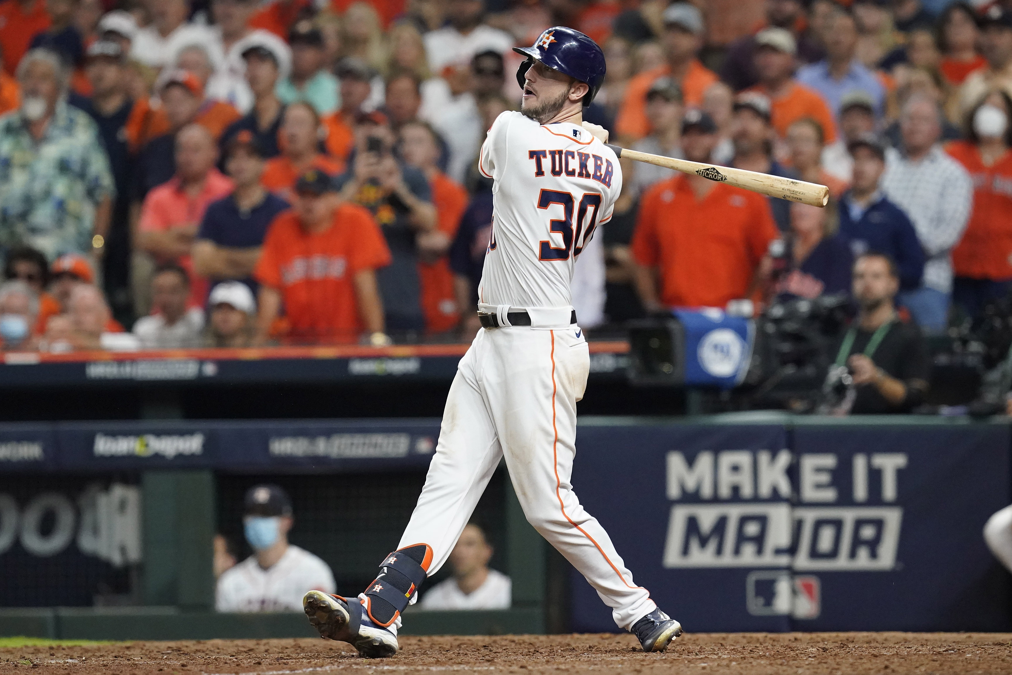 Houston Astros right fielder Kyle Tucker (30) hits a three run home run in the eighth inning against the Boston Red Sox during game six of the 2021 ALCS at Minute Maid Park.