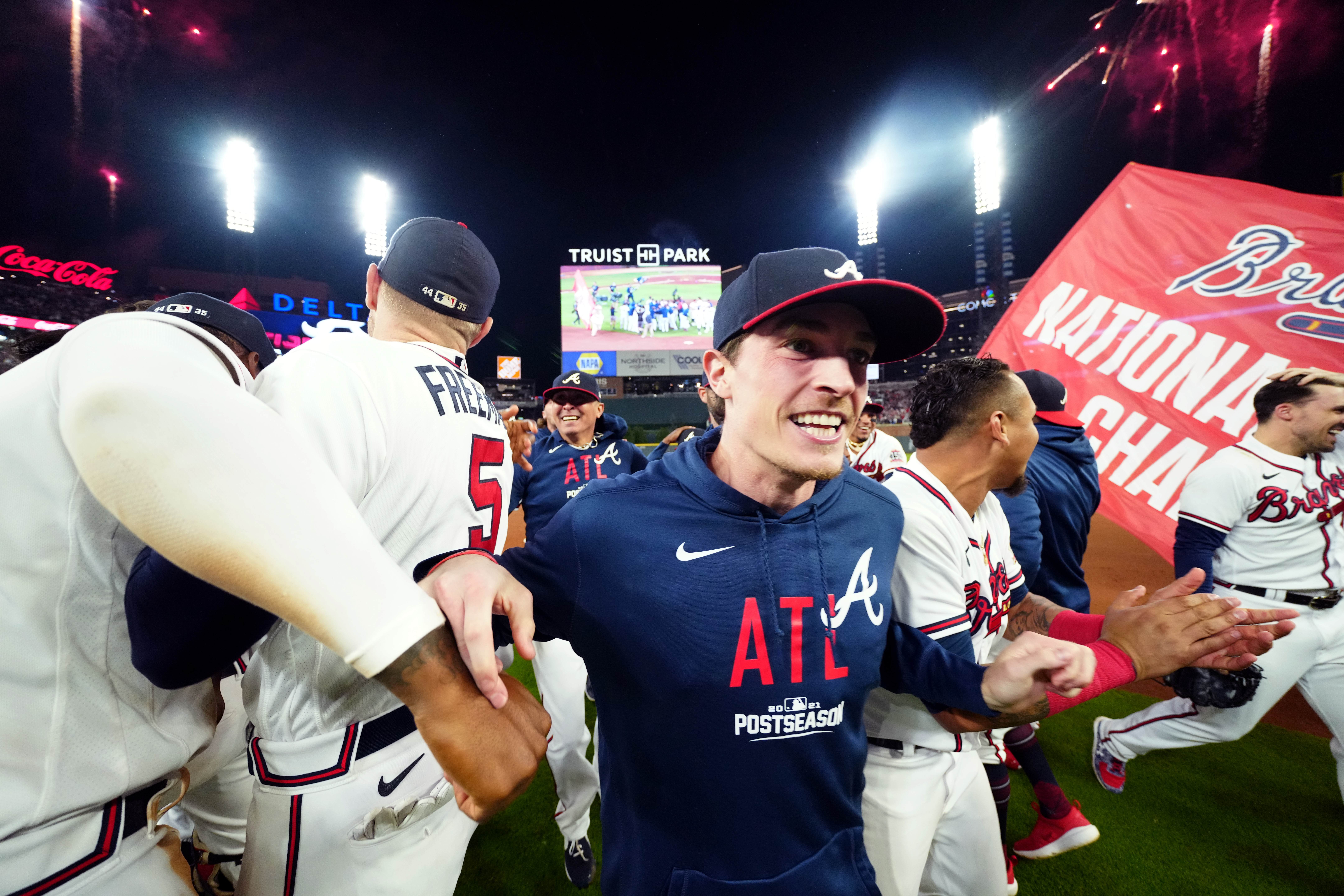 Max Fried #54 of the Atlanta Braves celebrates on the field with teammates after the Braves defeated the Los Angeles Dodgers in Game 6 of the NLCS to advance to the World Series at Truist Park on Saturday, October 23, 2021 in Atlanta, Georgia.