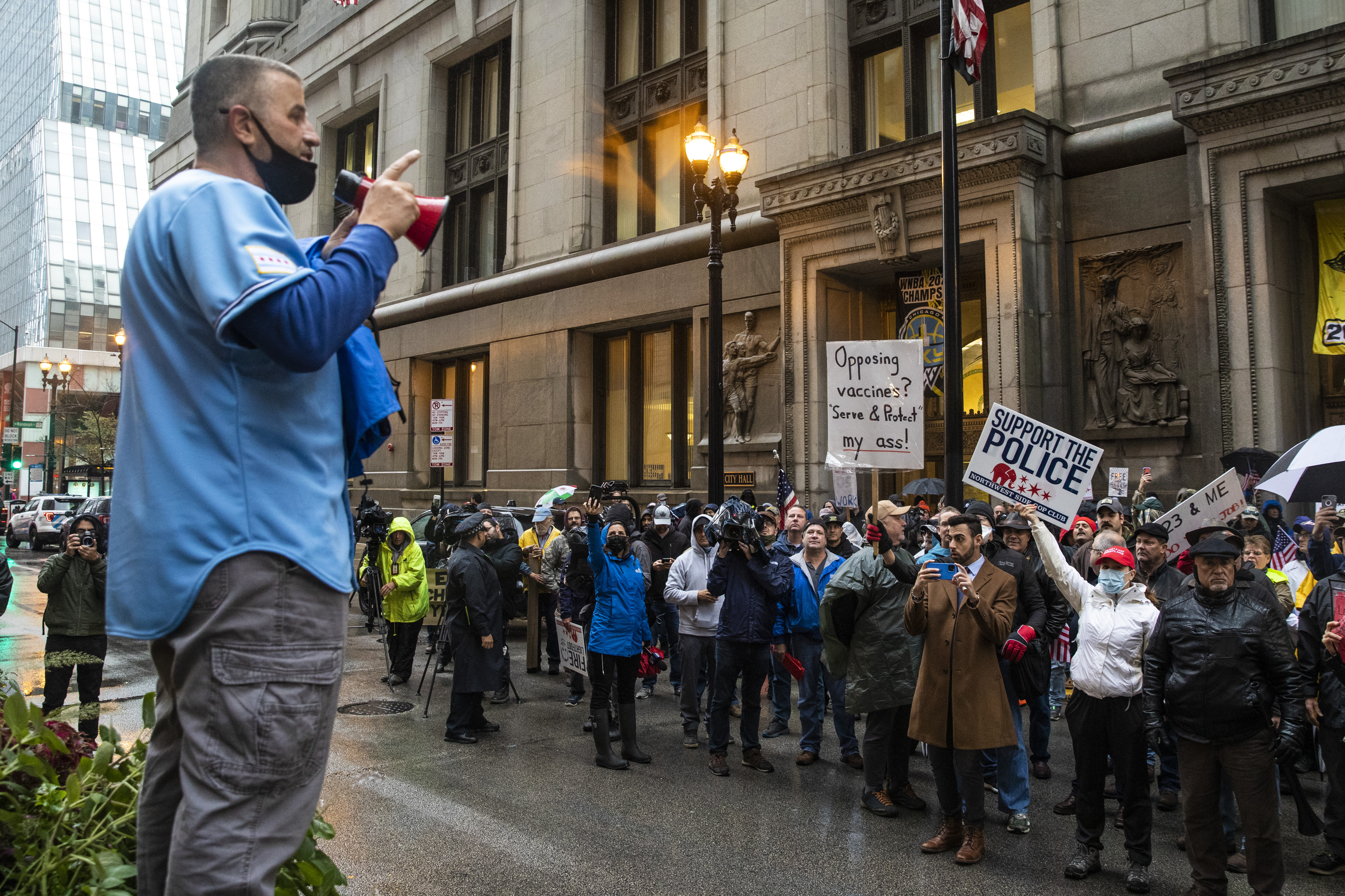 Fraternal Order of Police Lodge 7 President John Catanzara addresses a group of union protesters and their supporters outside City Hall as they rally against a requirement that police, like all other city employees, get the COVID-19 vaccine.