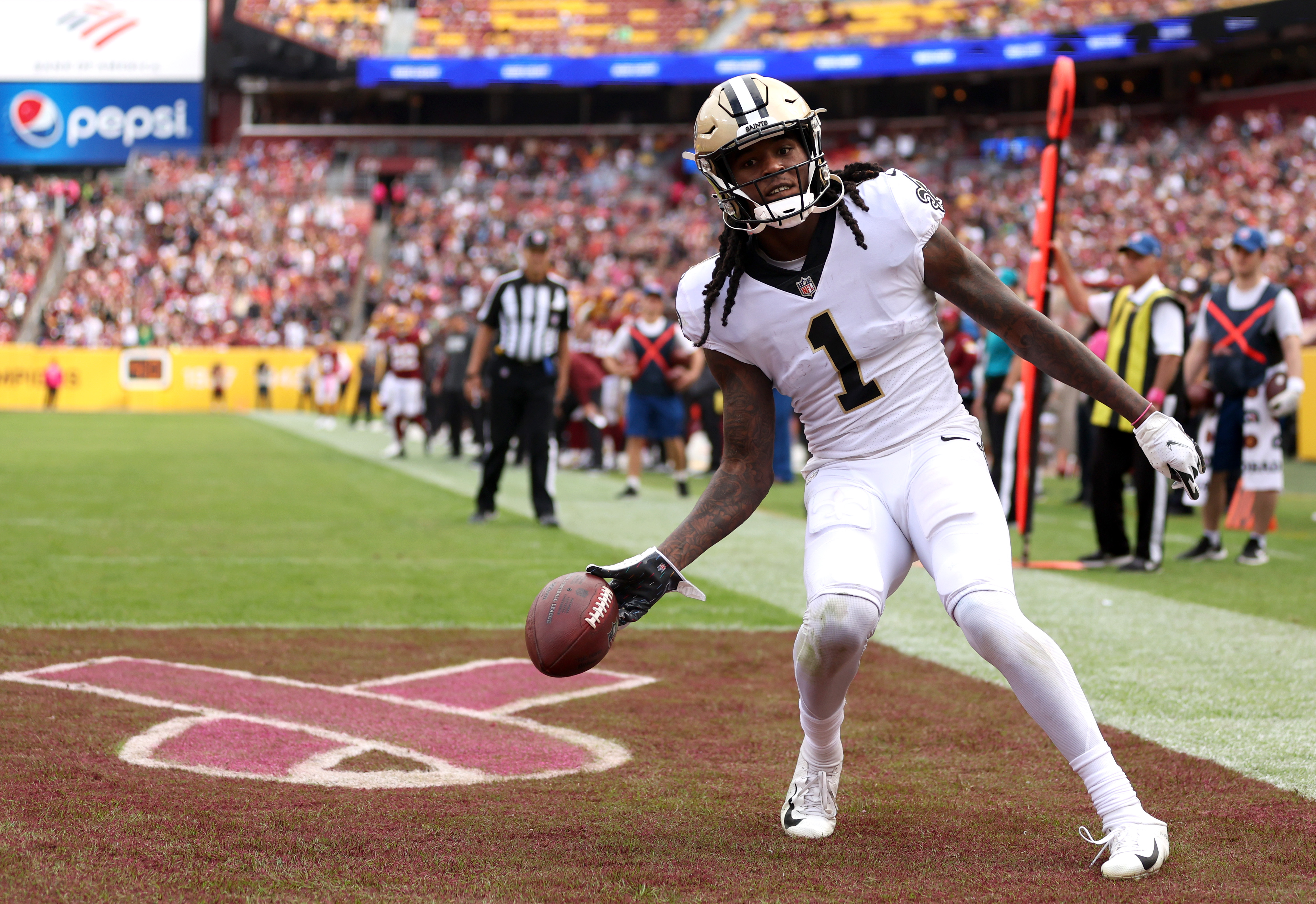 Marquez Callaway #1 of the New Orleans Saints celebrates in the end zone after scoring a touchdown during the second half against the Washington Football Team at FedExField on October 10, 2021 in Landover, Maryland.