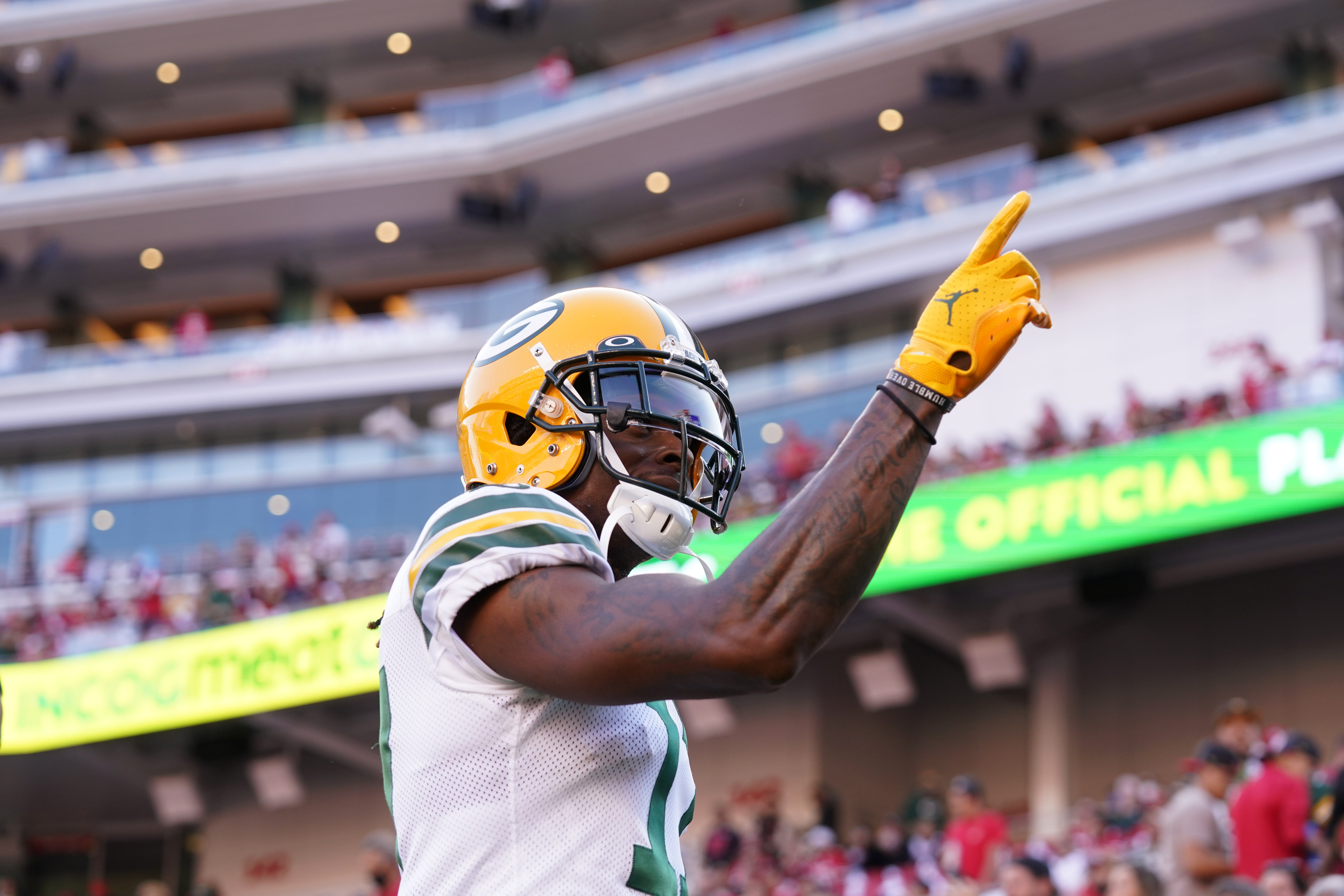 Green Bay Packers wide receiver Davante Adams (17) points towards the crowd before the start of the game against the San Francisco 49ers at Levi's Stadium.