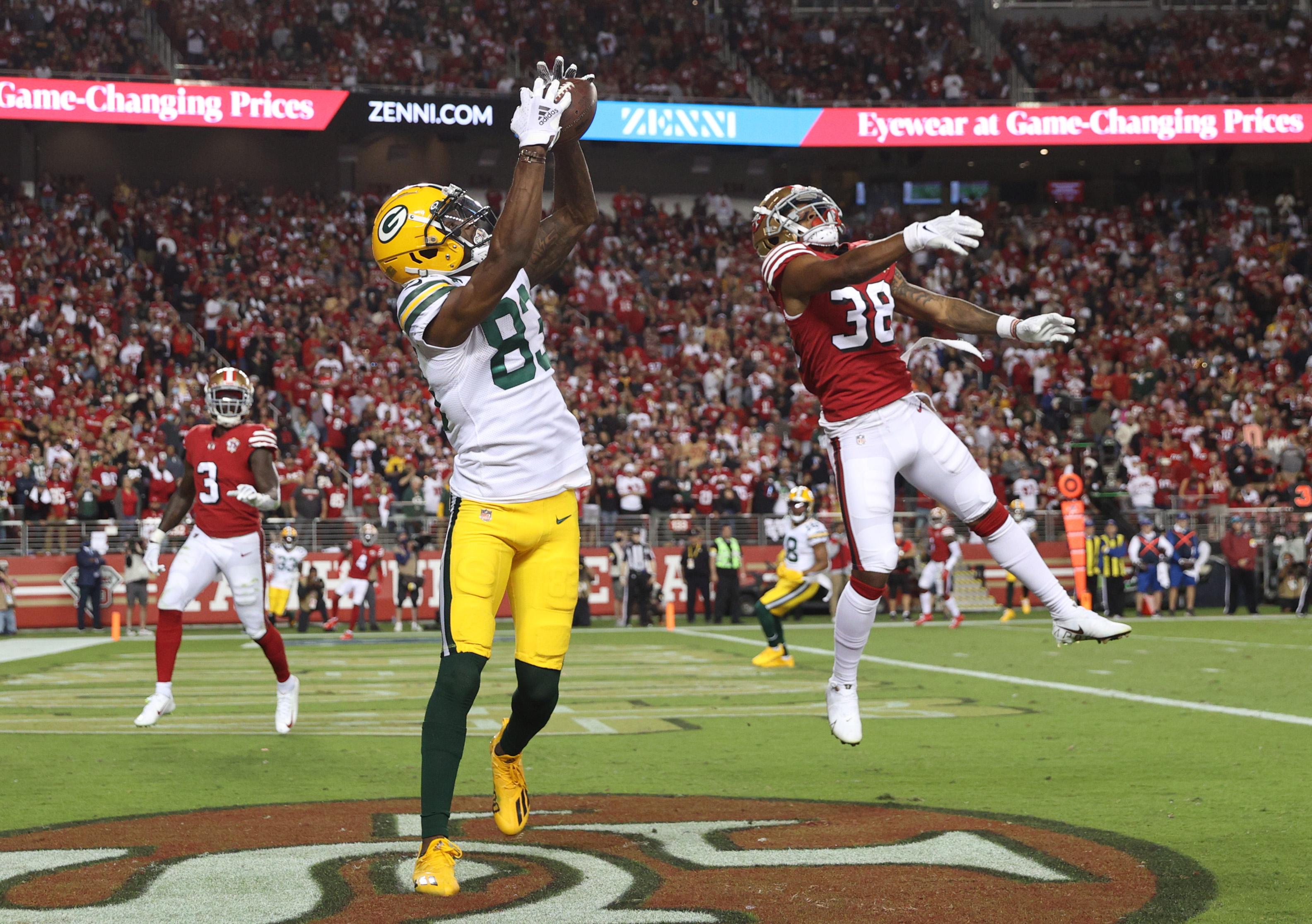 Marquez Valdes-Scantling #83 of the Green Bay Packers catches a touchdown pass during the second half against the San Francisco 49ers in the game at Levi's Stadium on September 26, 2021 in Santa Clara, California.
