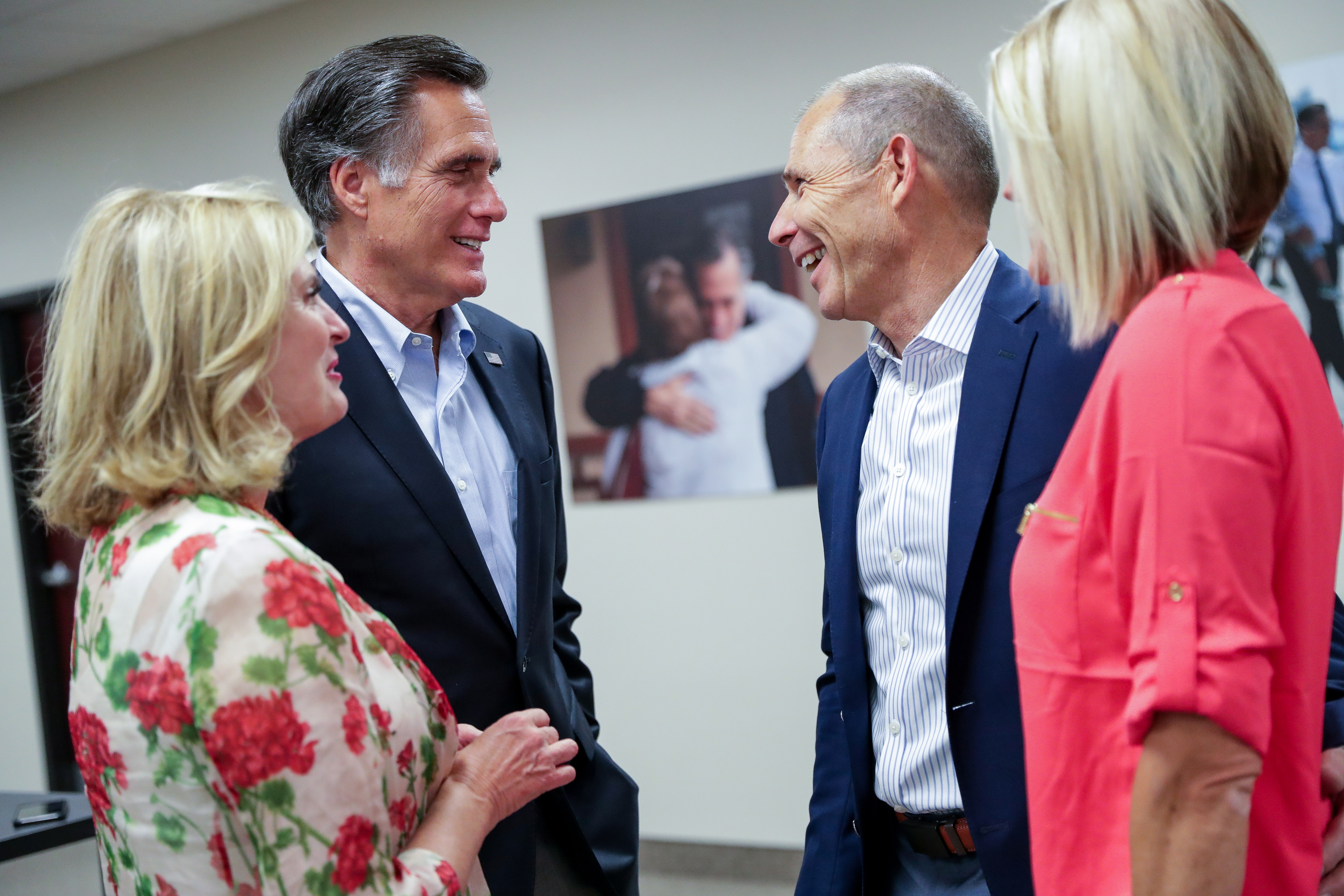 Sen. Mitt Romney and Rep. John Curtis chat after claiming victory in their primary elections.