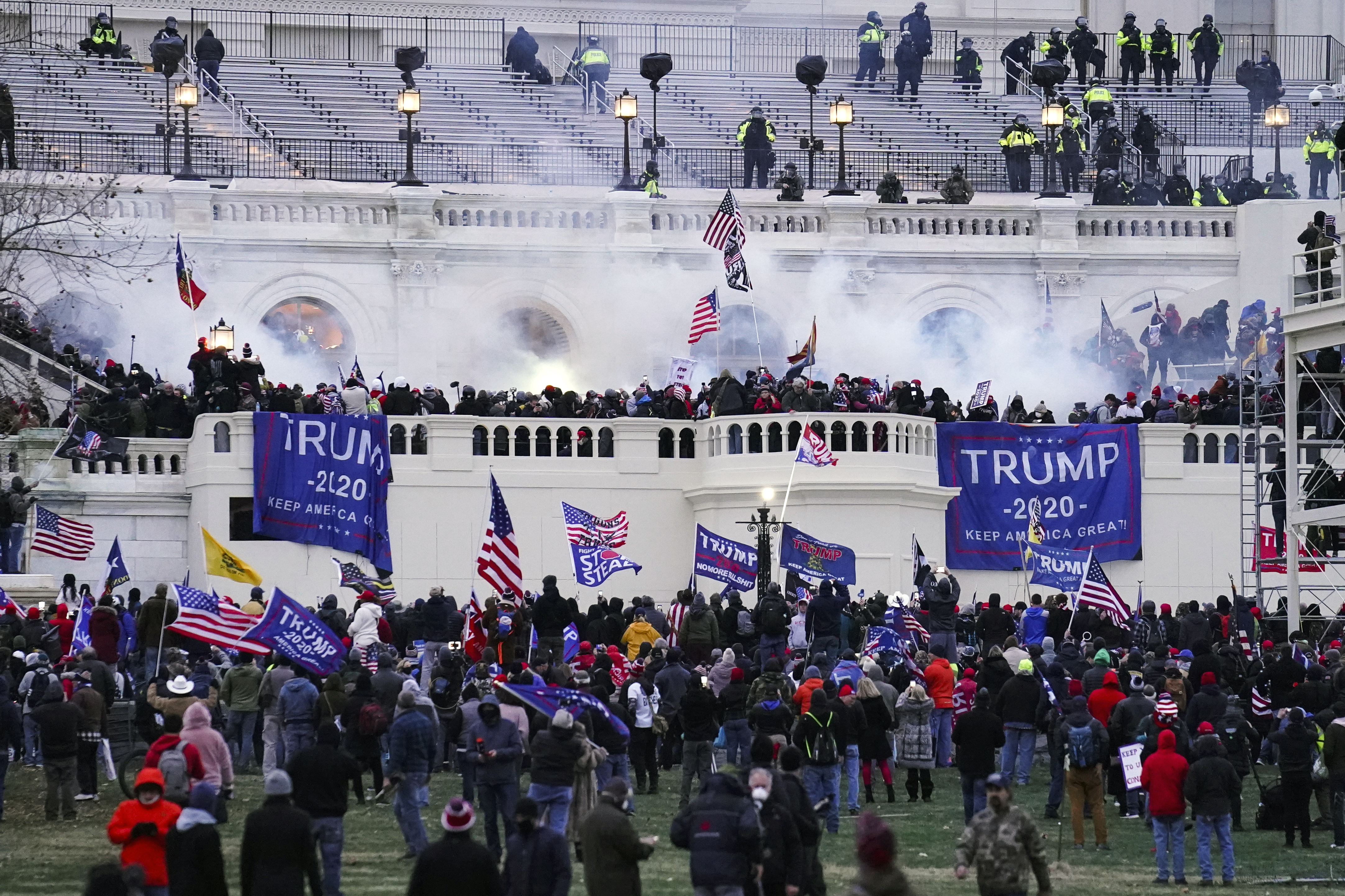 FILE - In this Jan. 6, 2021 file photo, violent protesters, loyal to President Donald Trump, storm the Capitol in Washington. (AP Photo/John Minchillo) ORG XMIT: WX102