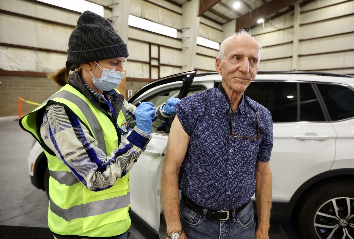 Kelsey Wetzel, a registered nurse with Davis County Community Health, gives a COVID-19 vaccine booster shot to William Boren.